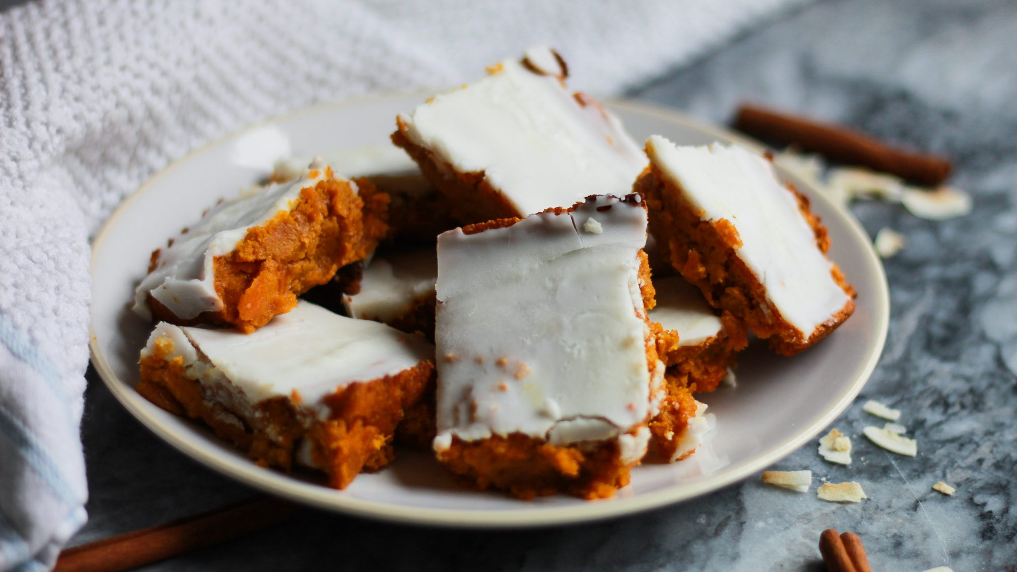 These vegan carrot cake bars packed with spice and sweetness! They're completely paleo, gluten free, and made with natural sweetener for a decadent spring dessert!