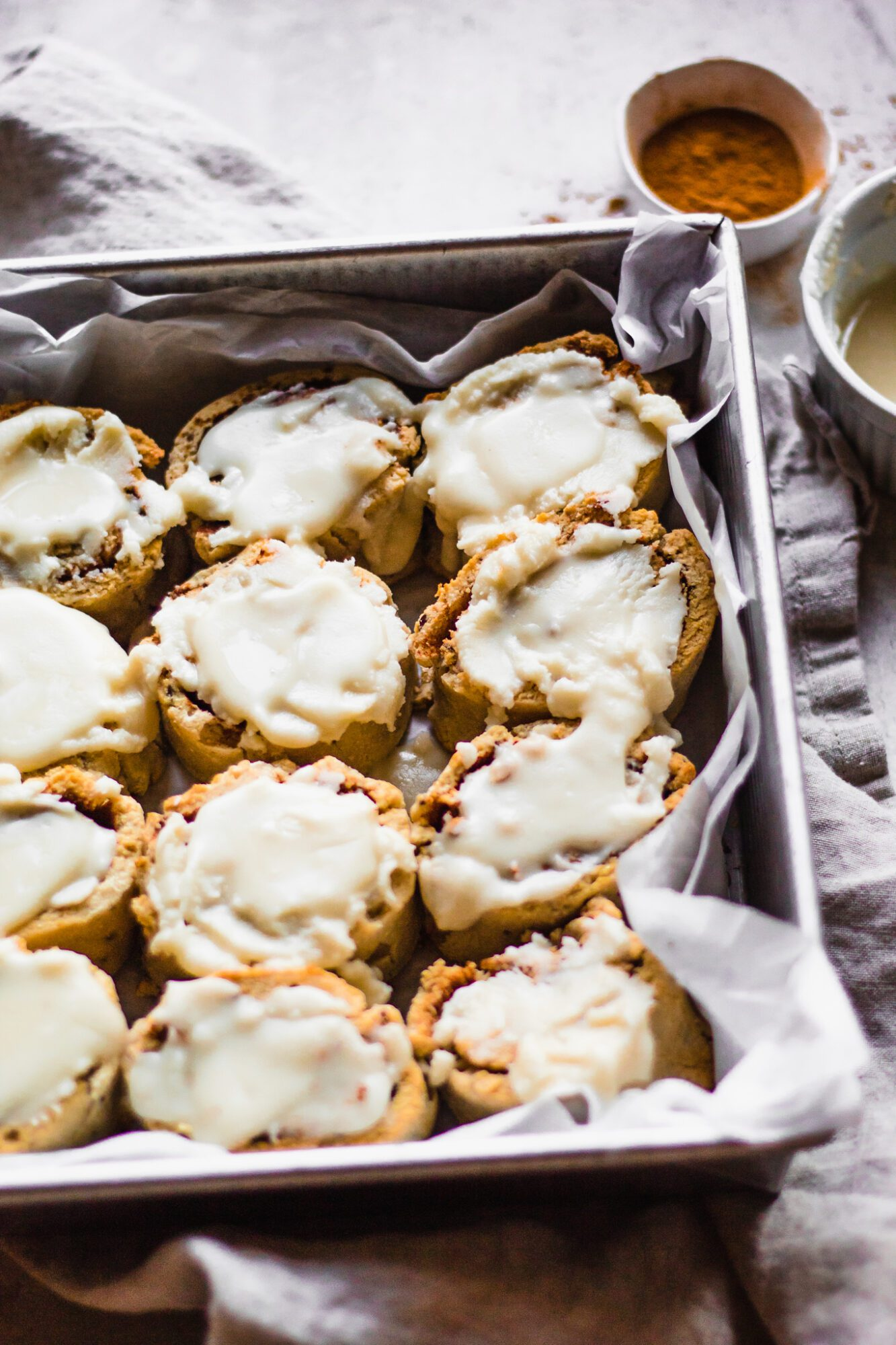 off centered cinnamon rolls with icing