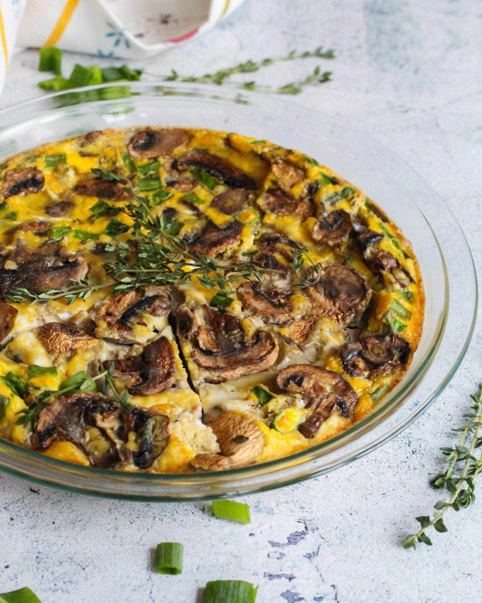 Paleo frittata baked with mushrooms, spinach, and fresh herbs for a delicious and easy breakfast! This recipe is Whole30 compliant, paleo, gluten free, and dairy free!