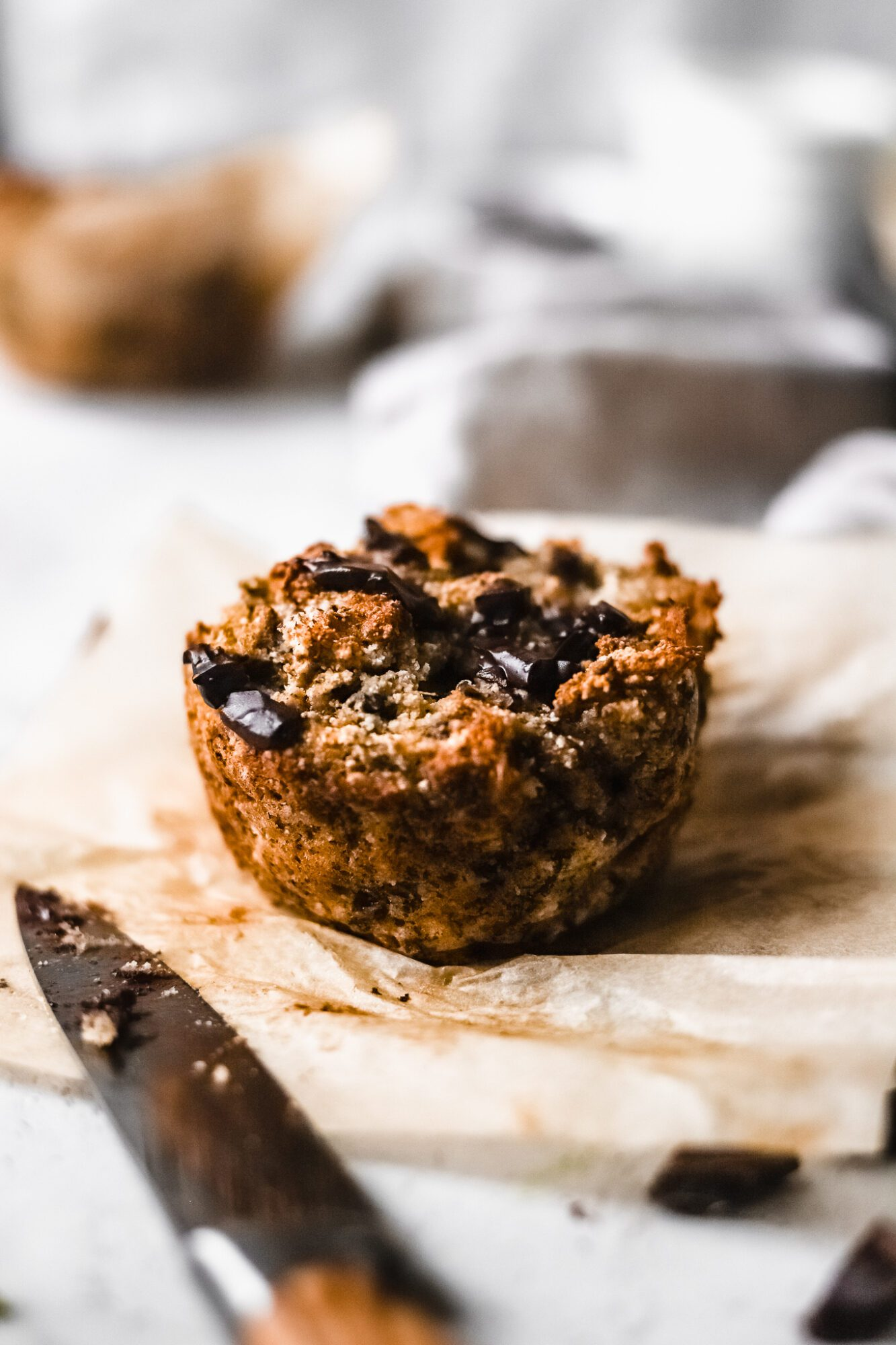 banana muffins with knife
