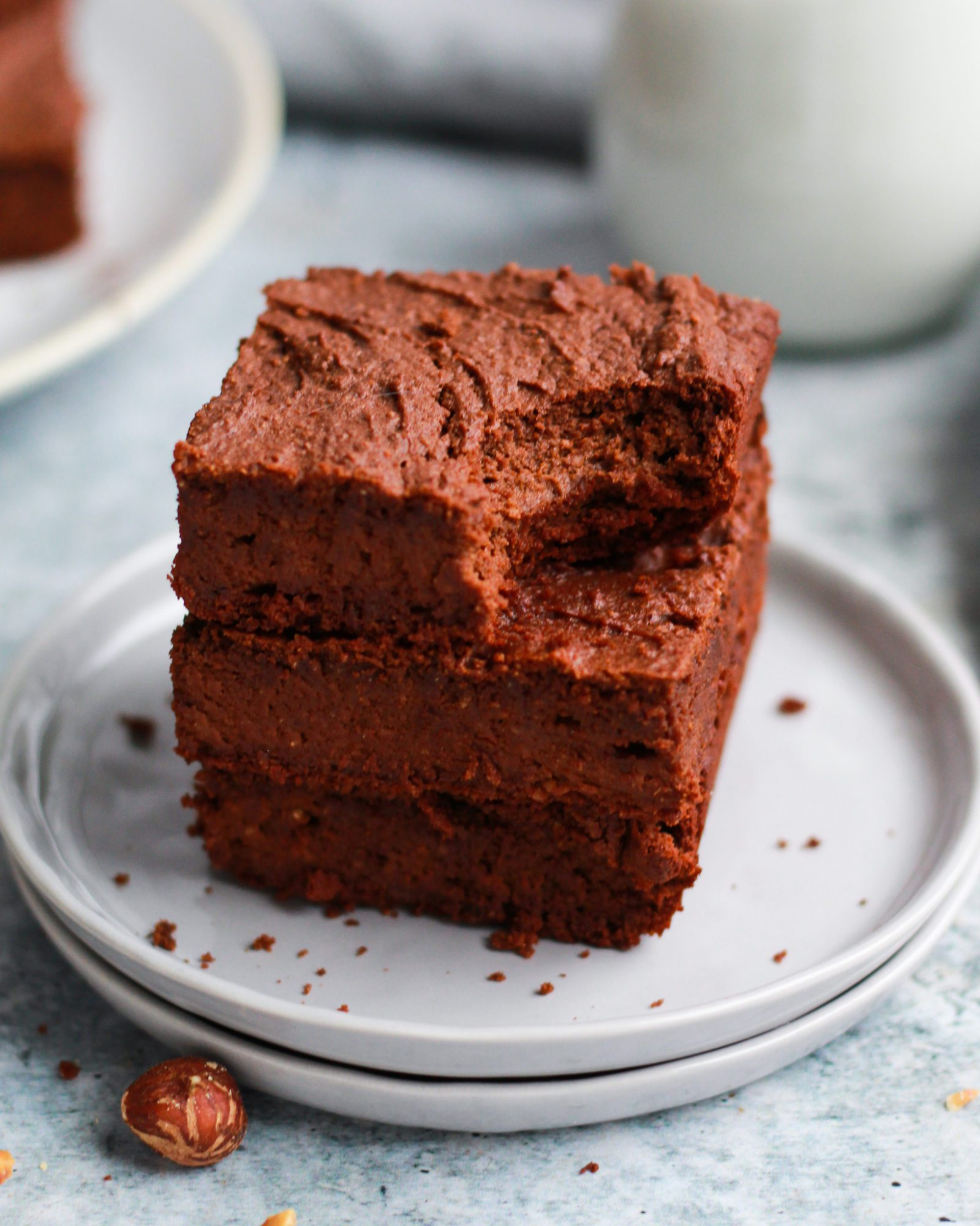 Stack of healthy vegan Nutella brownies with a bite out of it