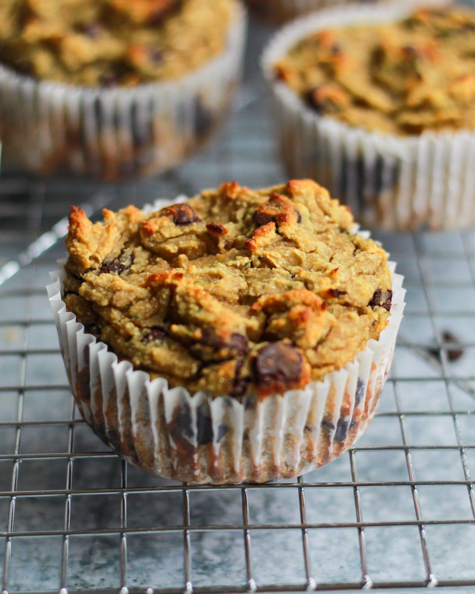 paleo chocolate chip zucchini muffin on cooling rack