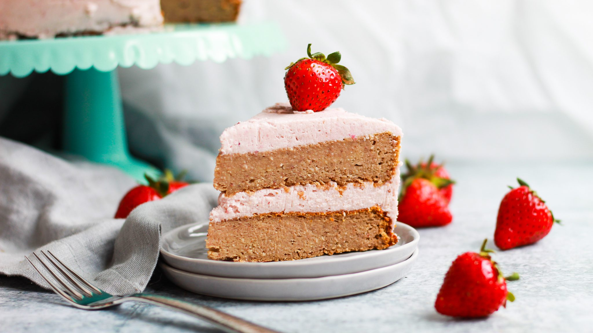 header of strawberry cake with strawberry frosting