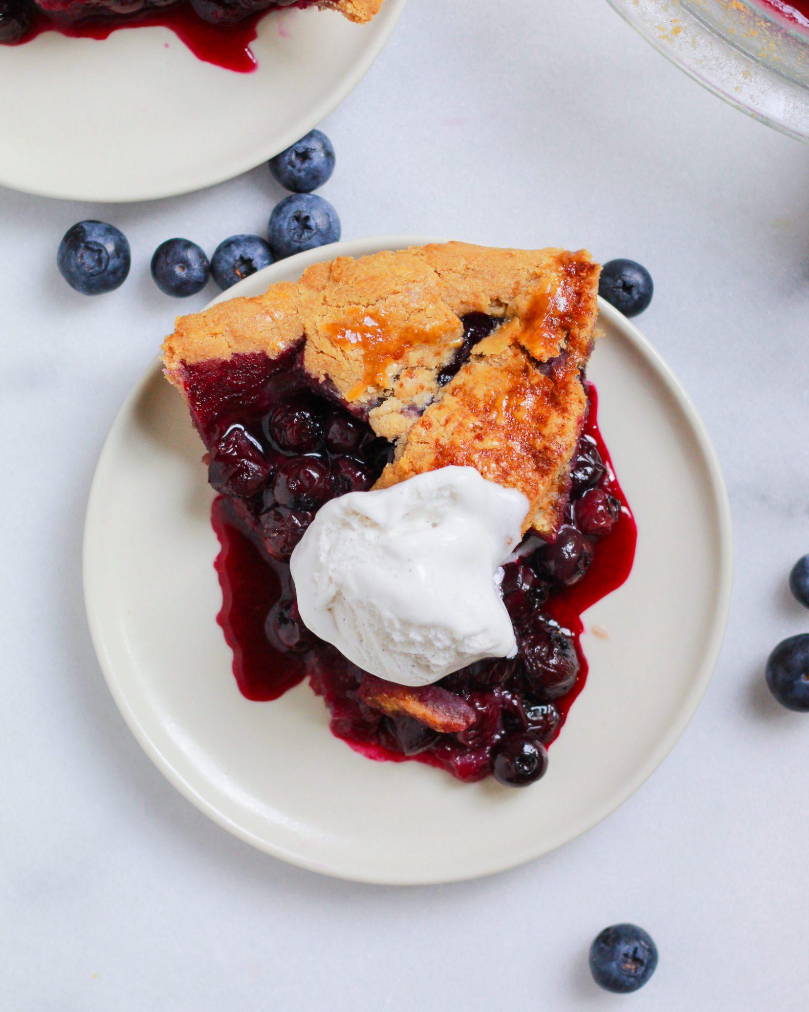 blueberry pie slice with ice cream