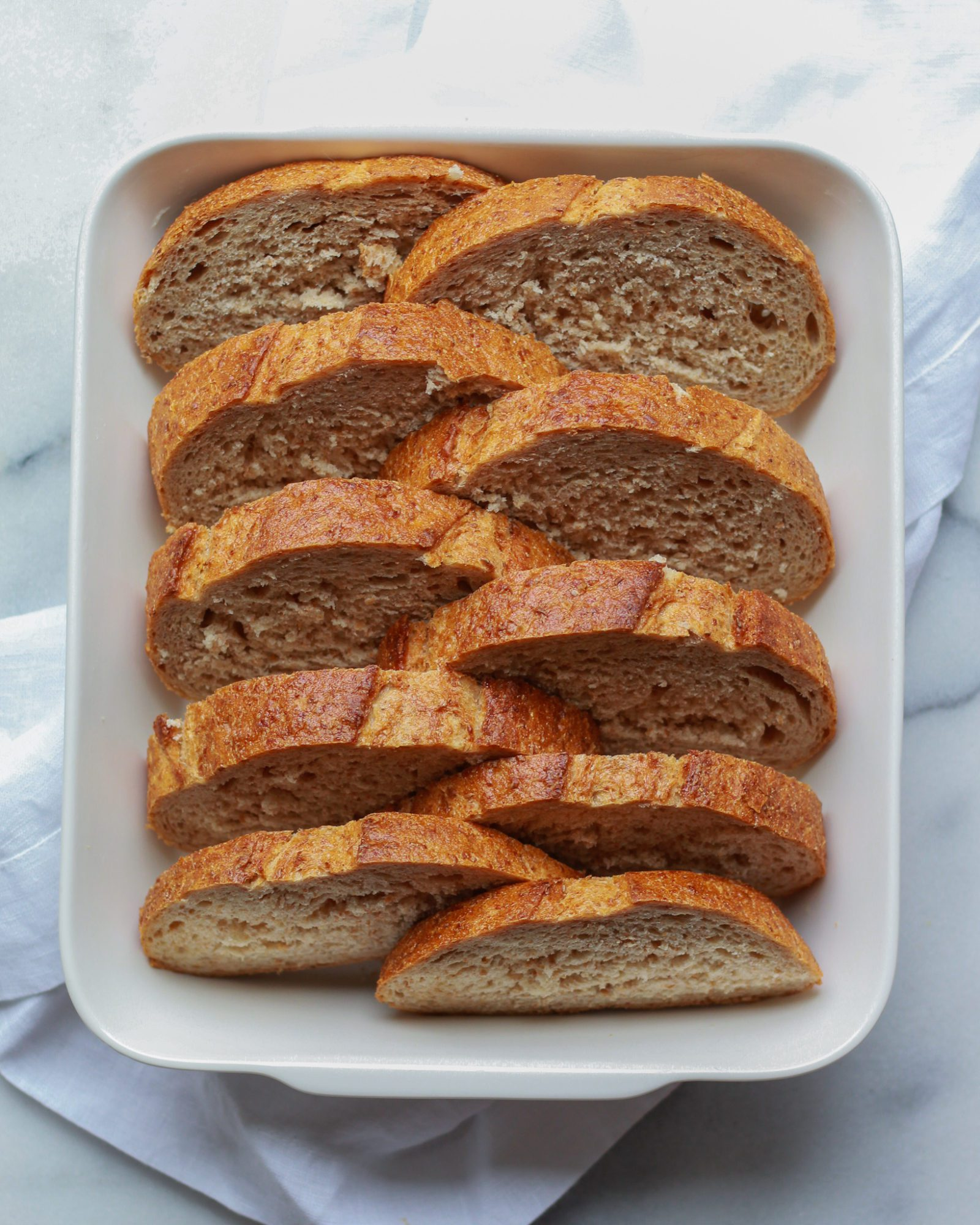 sliced french bread in casserole dish