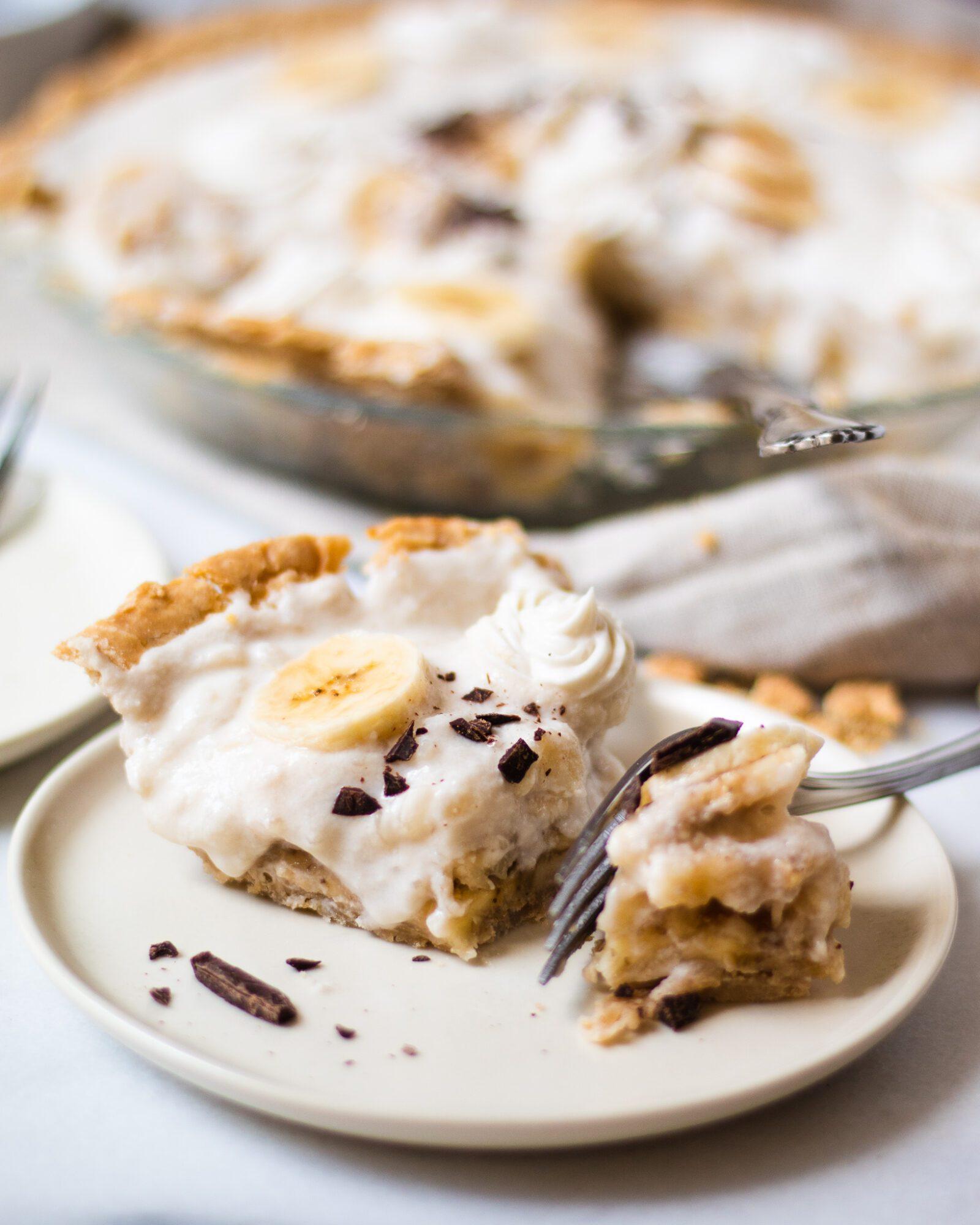 piece of banana cream pie being eaten