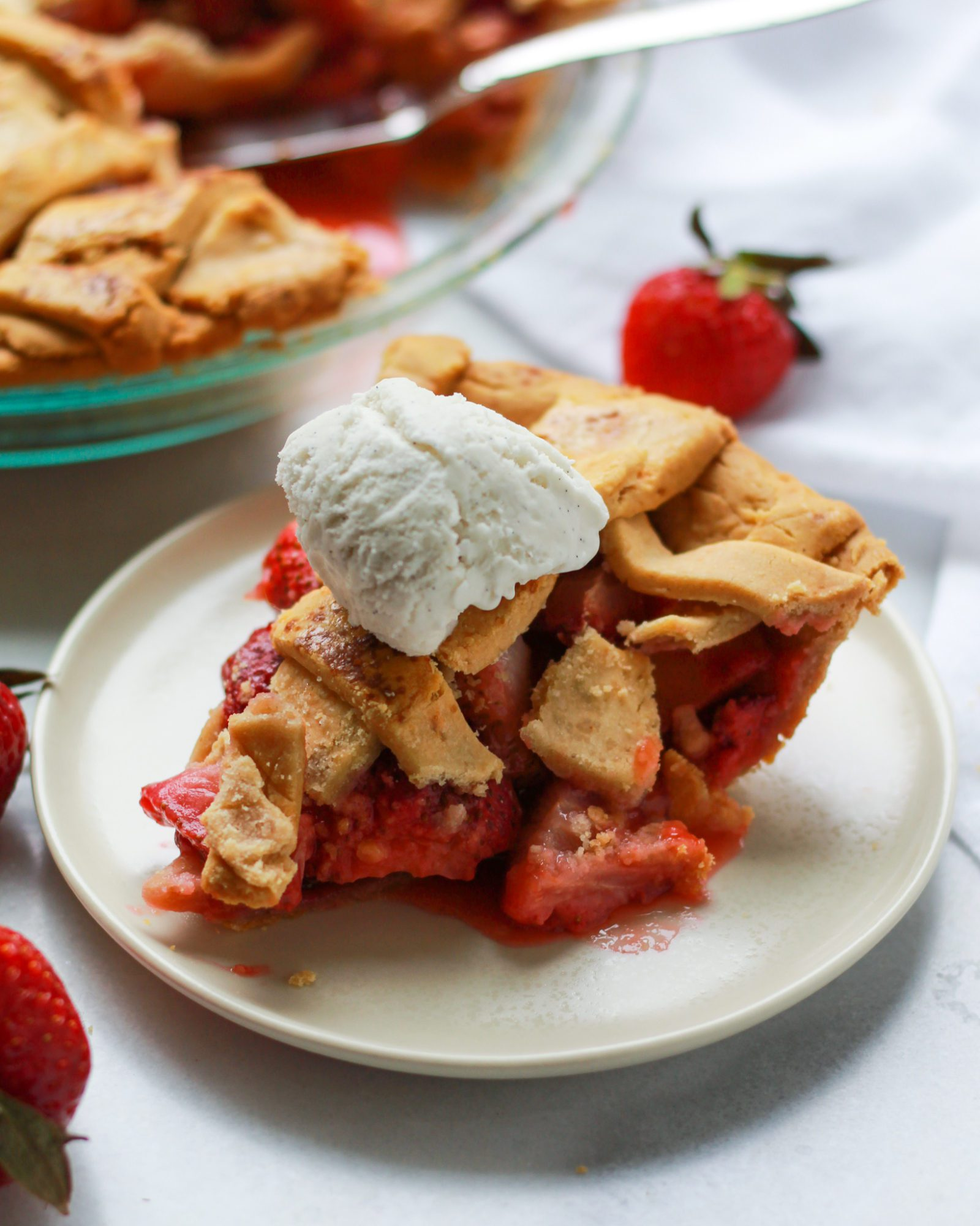 slice of rhubarb pie with a scoop of ice cream on top
