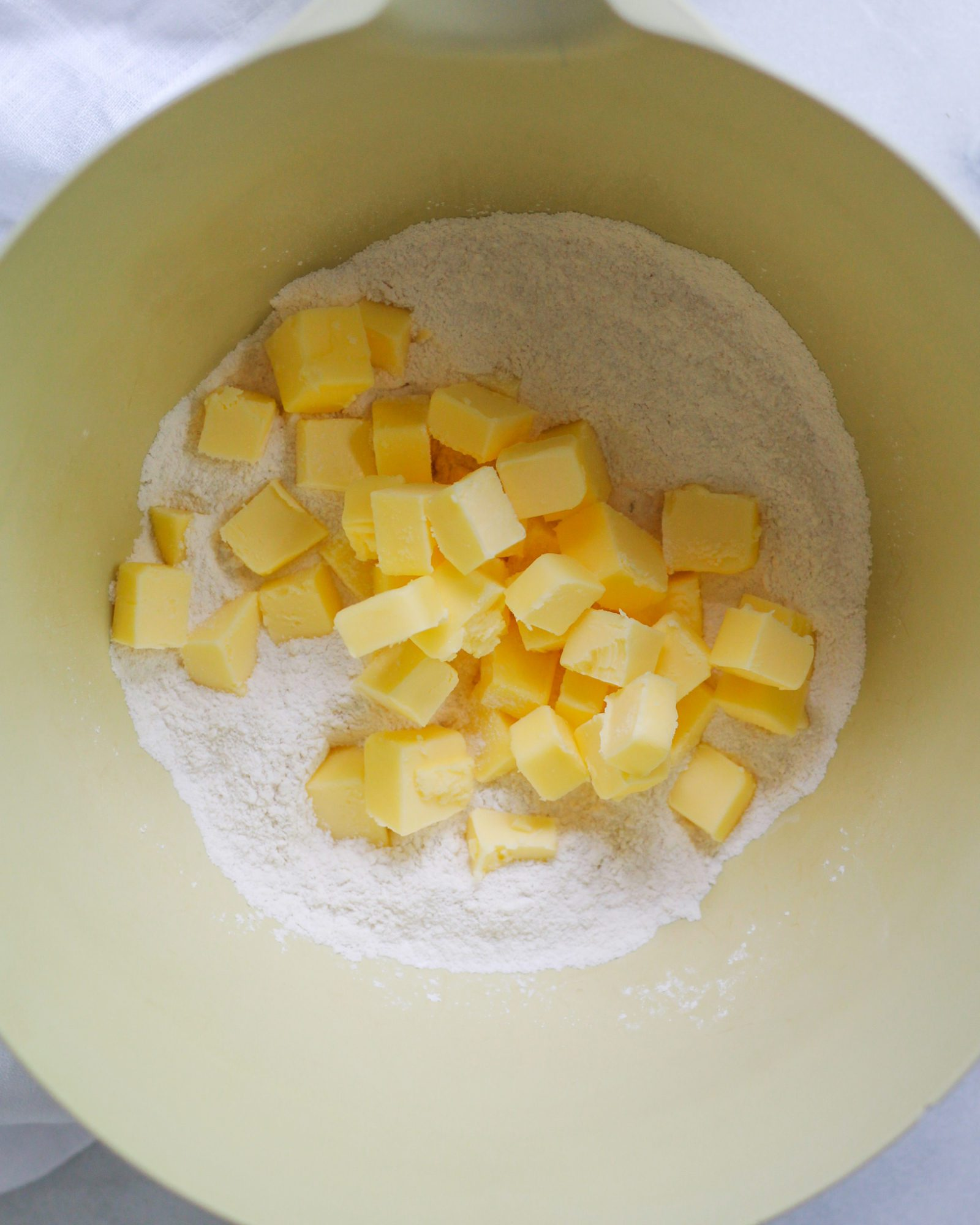 cubed butter in flour before cutting the butter into the flour
