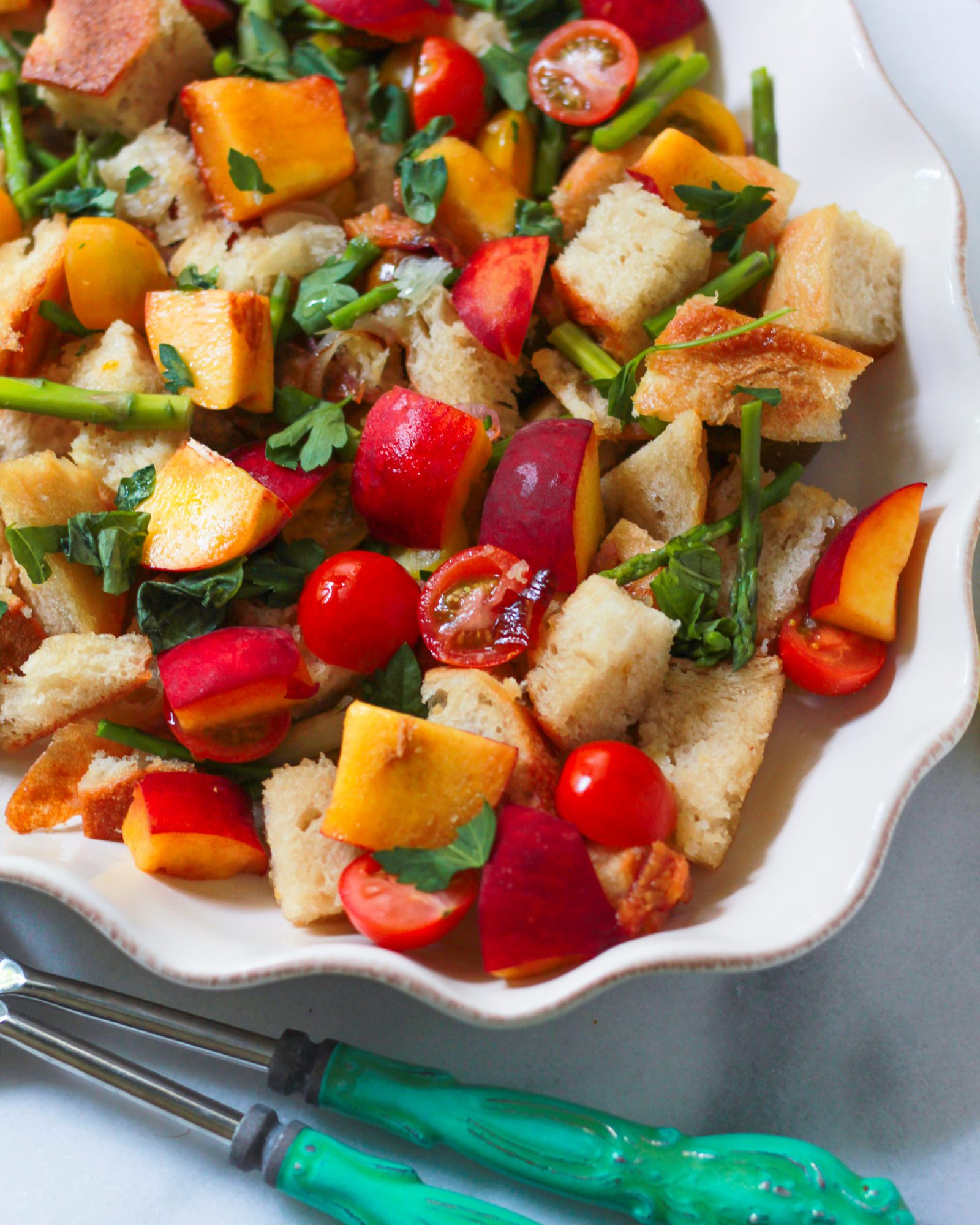 3/4 view of peach and tomato panzanella