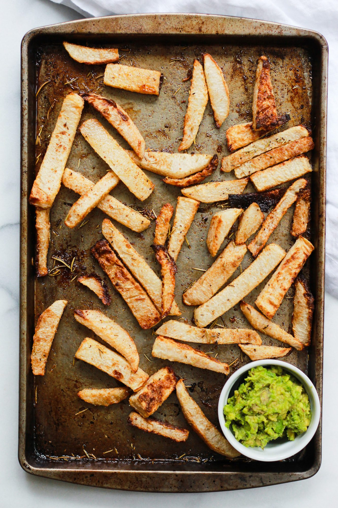 tray of baked jicama fries with guacamole