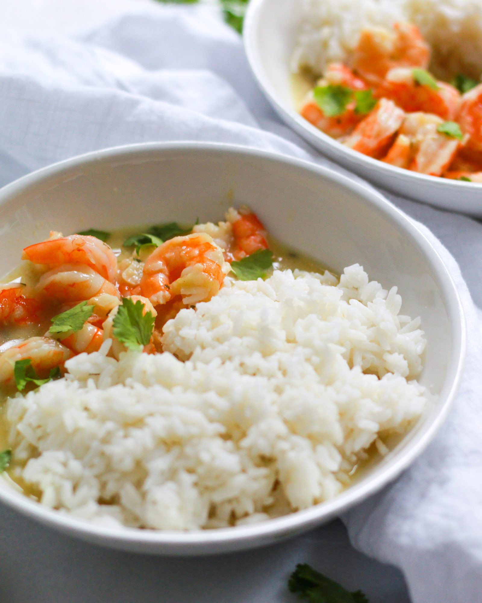 shot of coconut curry shrimp bowls