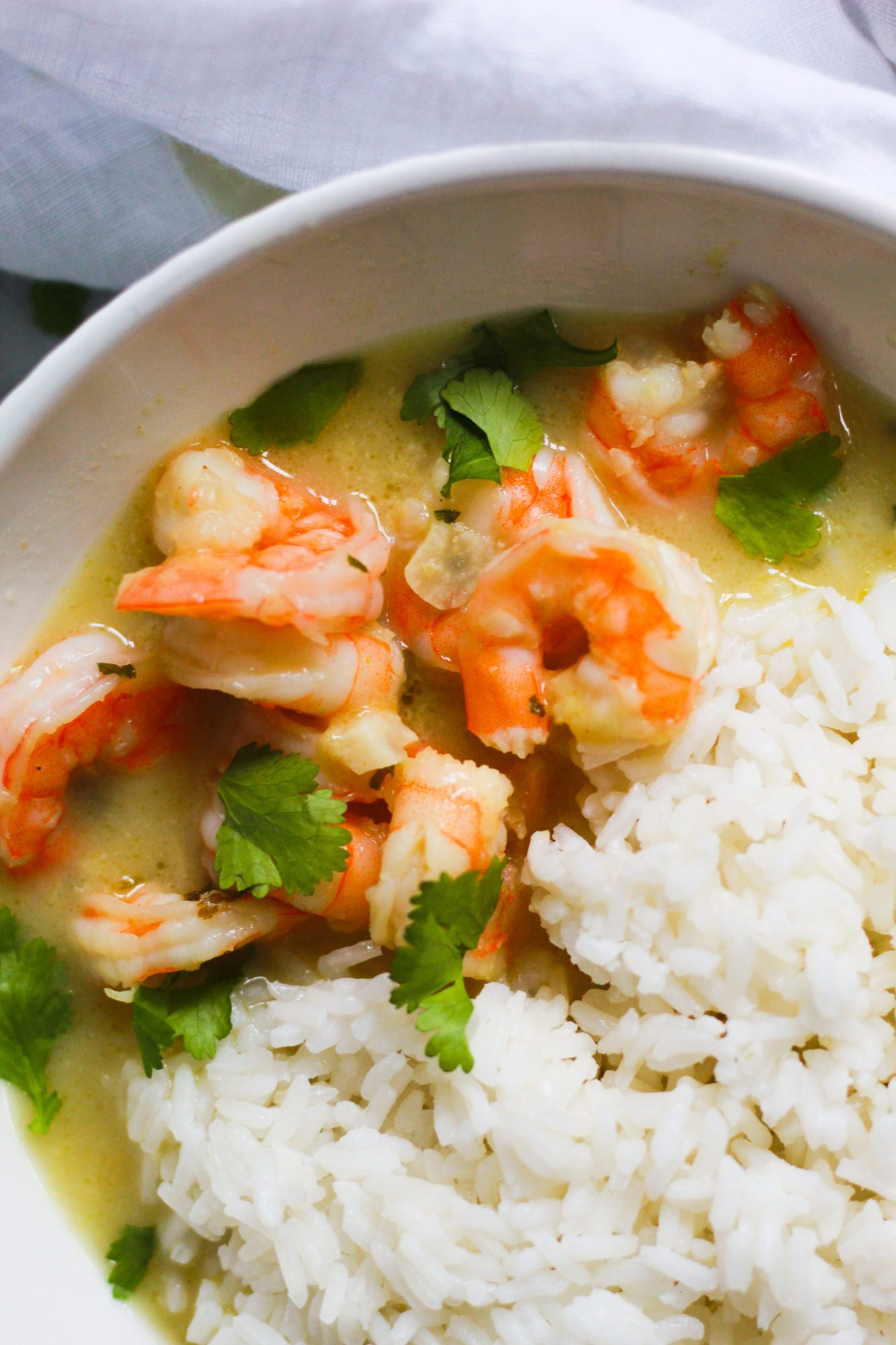 close up of thai coconut curry shrimp in bowl
