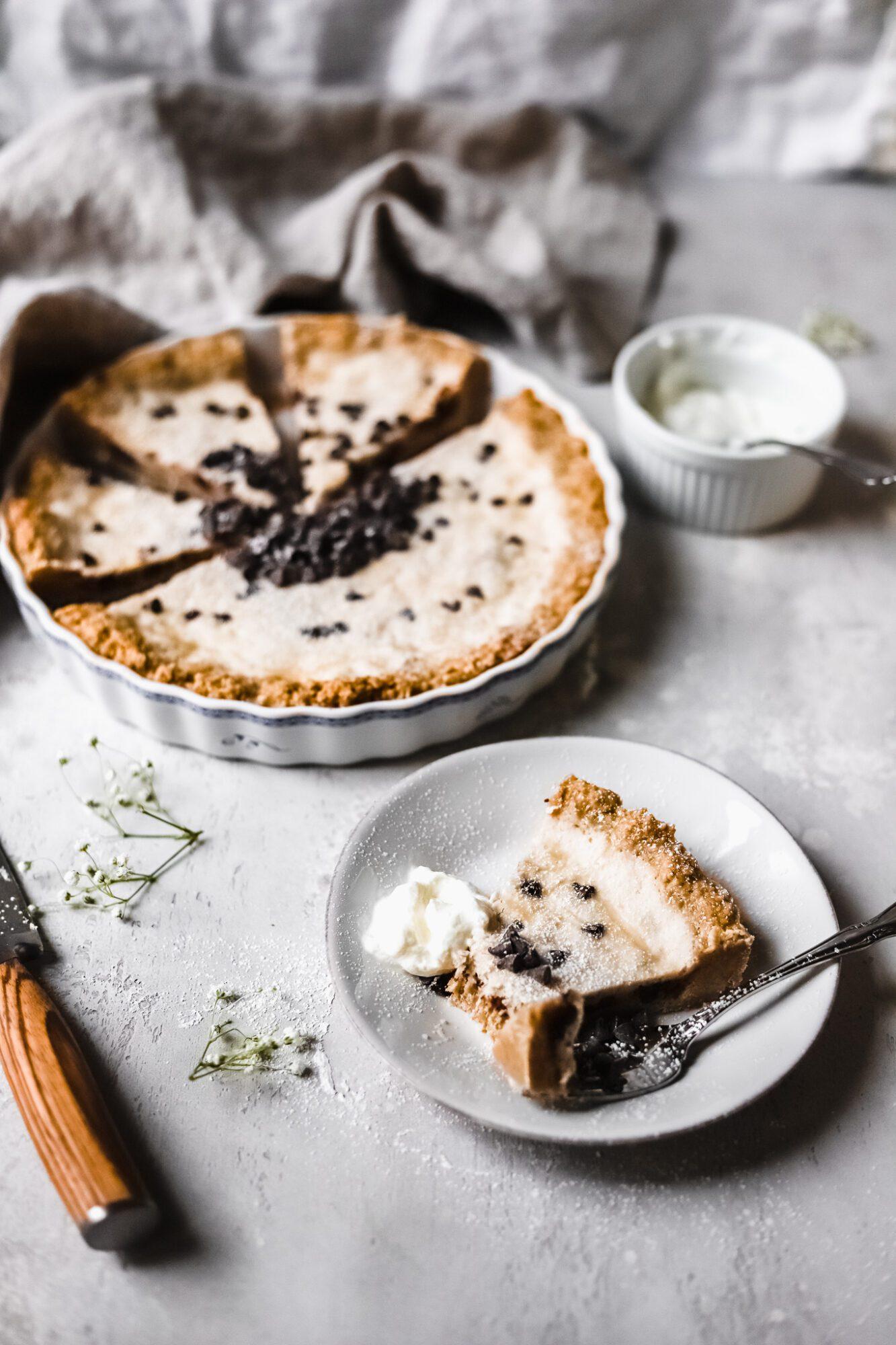 slice of vegan cannoli cheesecake with bite