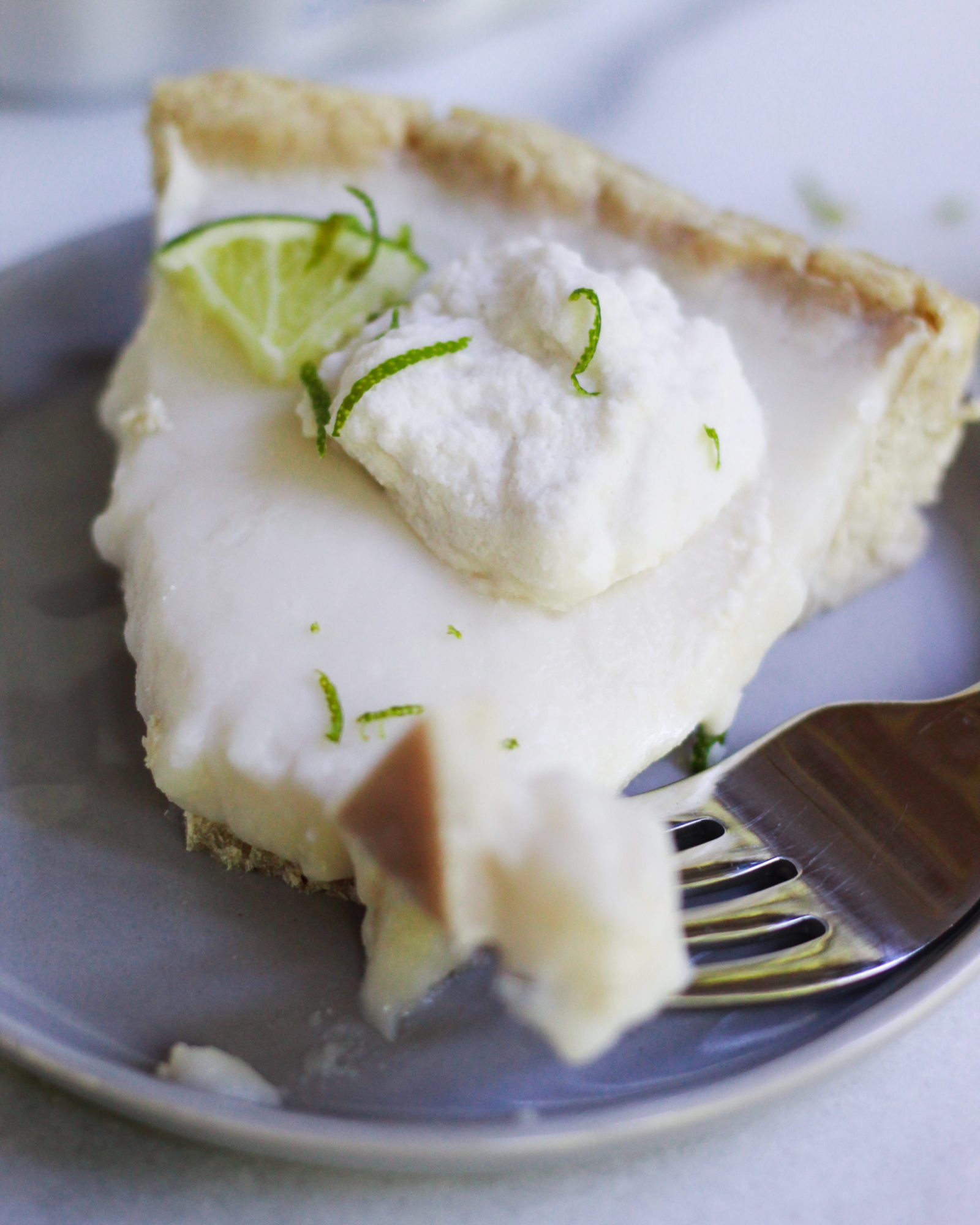 slice of key lime pie with vegan pie crust