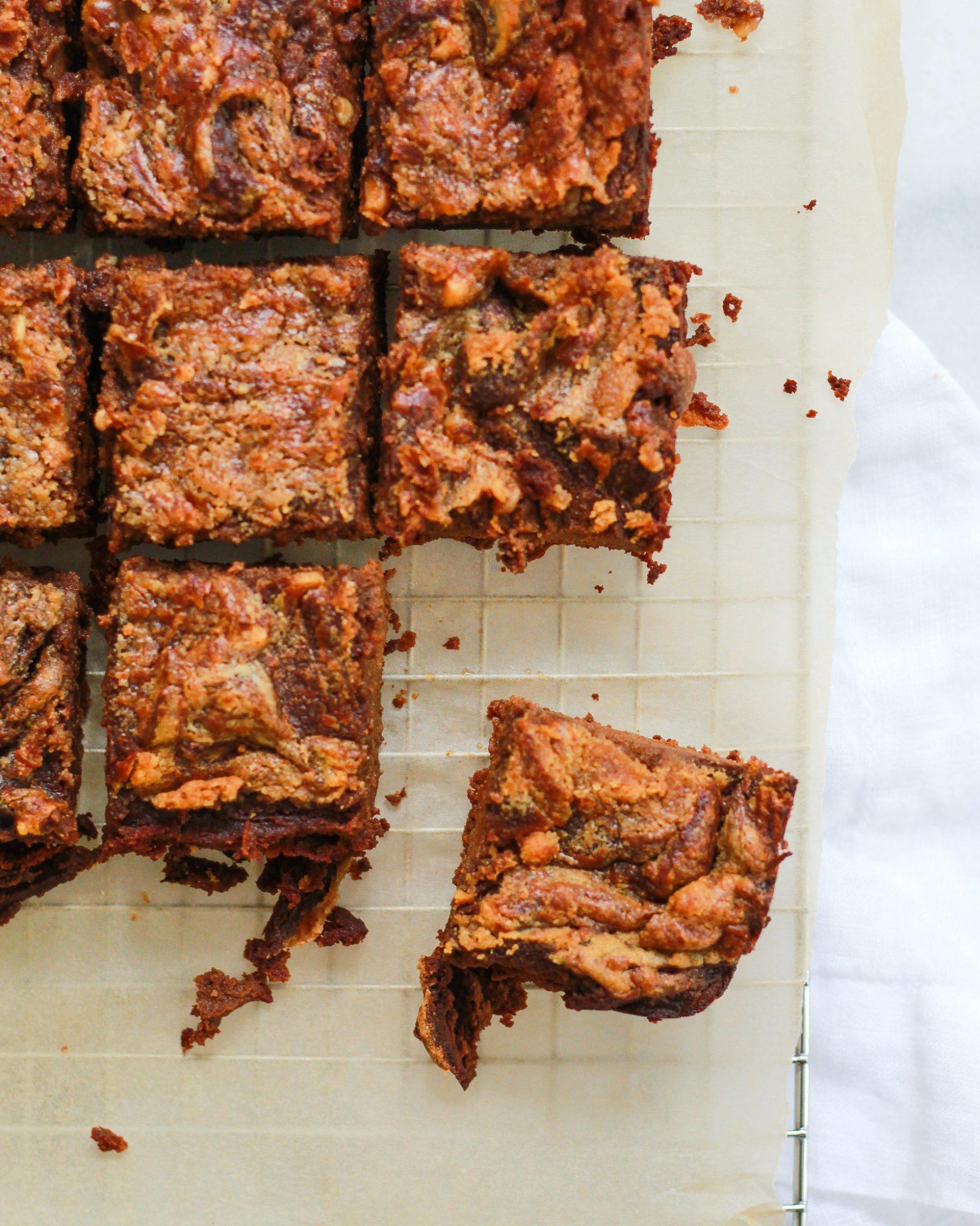 one peanut butter swirl brownie broken away from batch