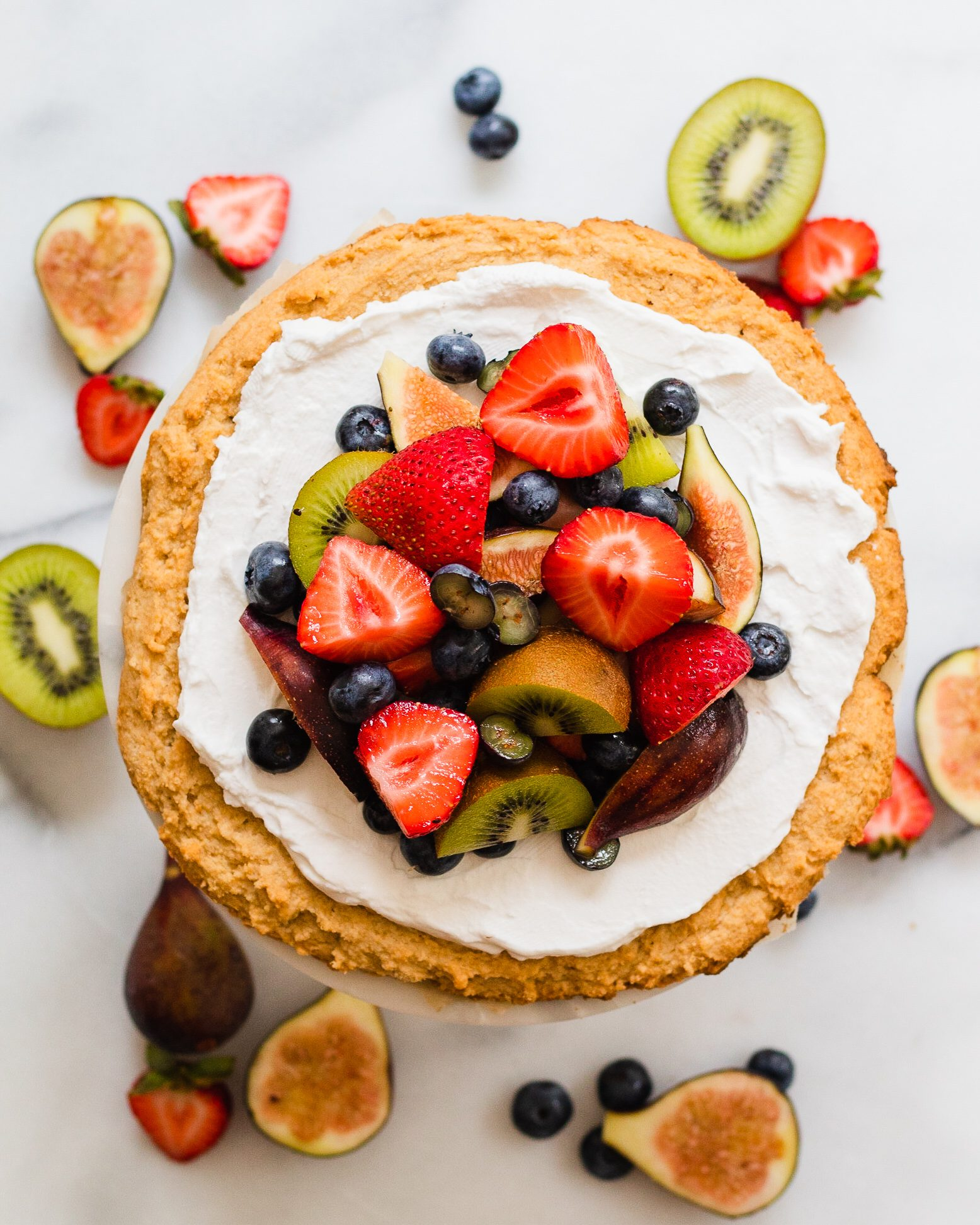 healthy fruit pizza on cake stand