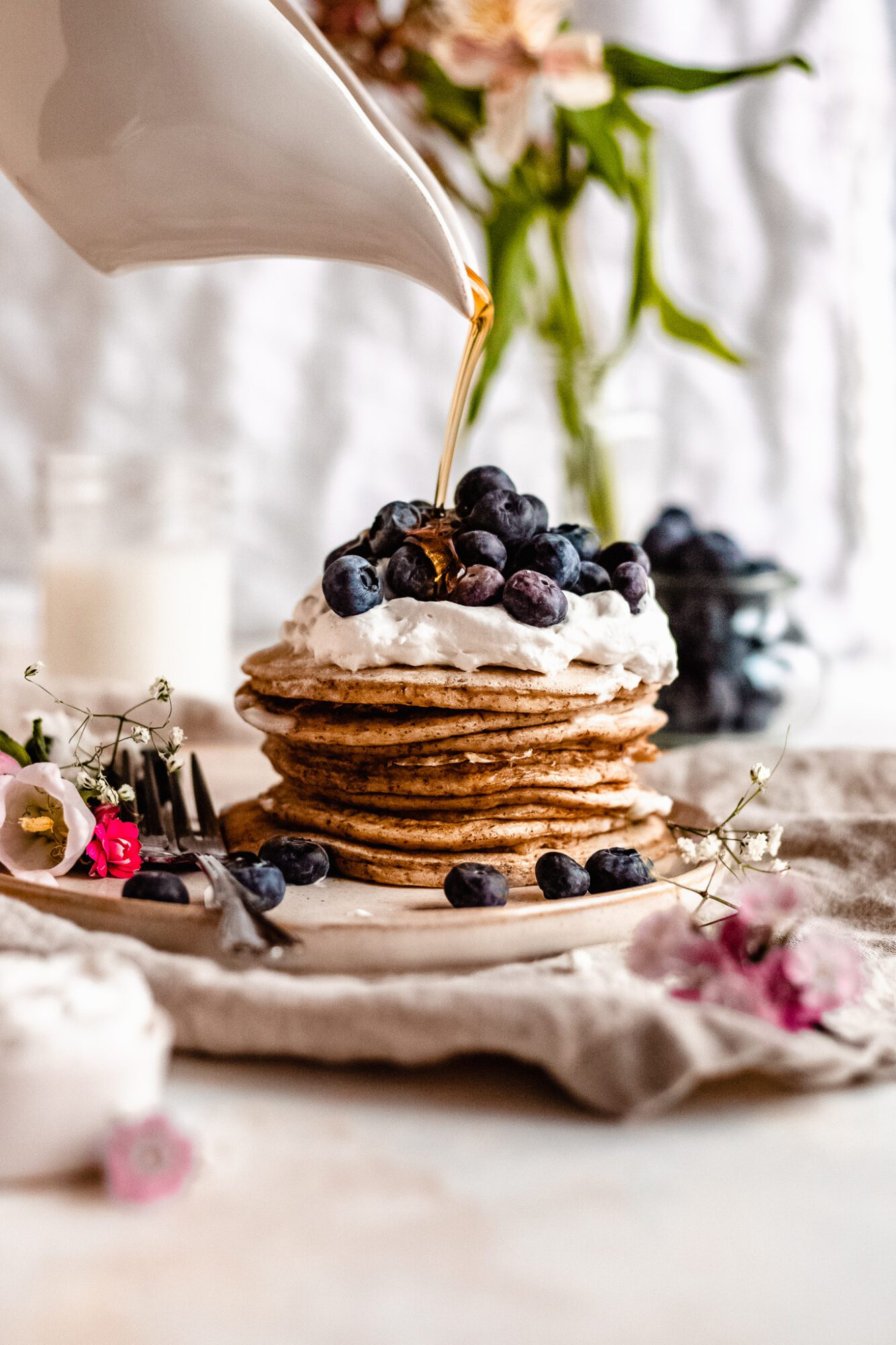 drizzle of maple syrup on vegan pancakes
