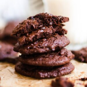 stack of chocolate brownie cookies on parchment paper