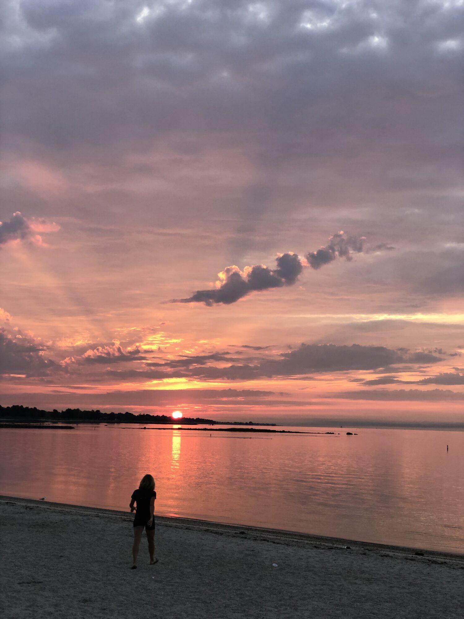 pink sky rising over ocean