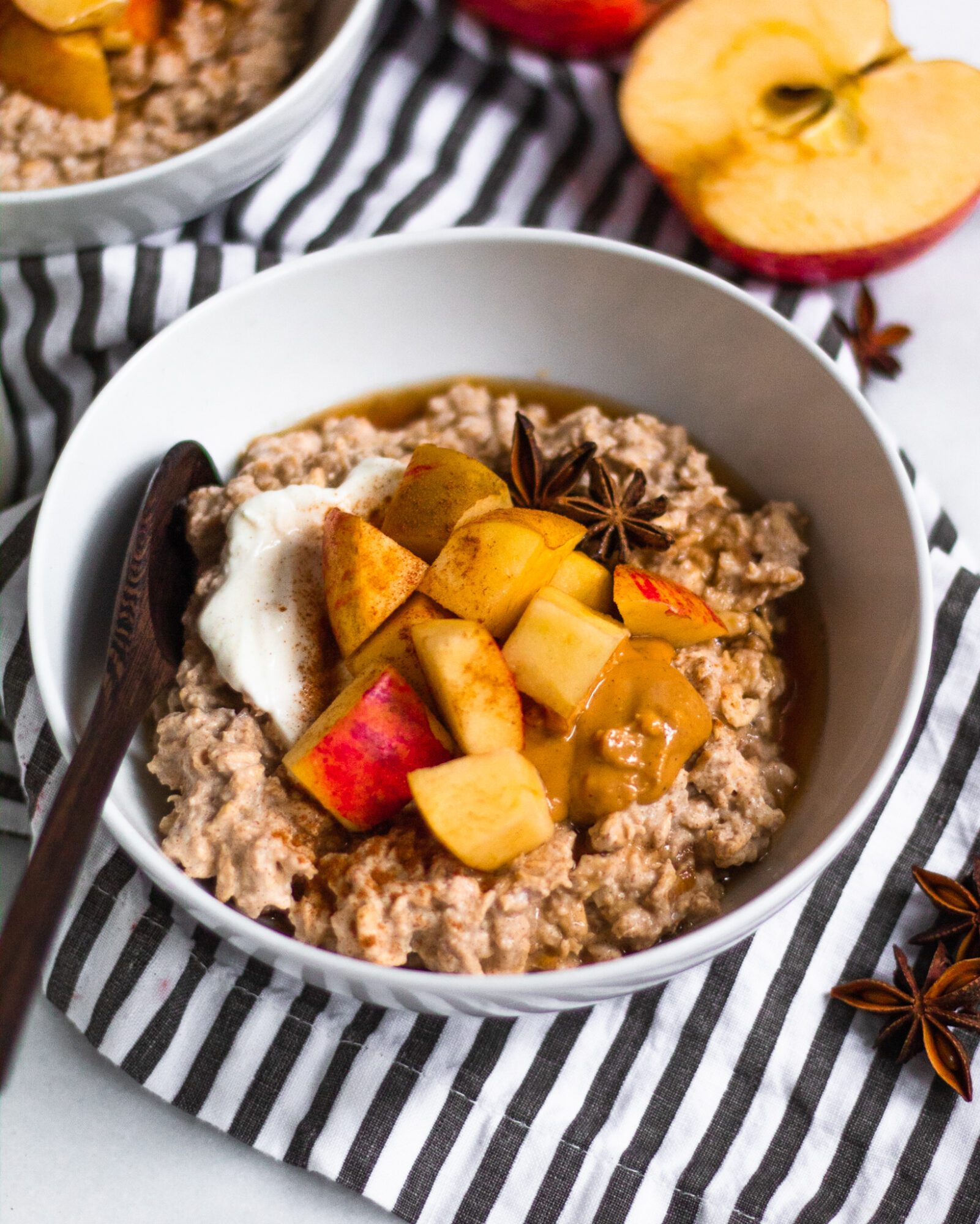 wooden spoon resting in bowl of oatmeal