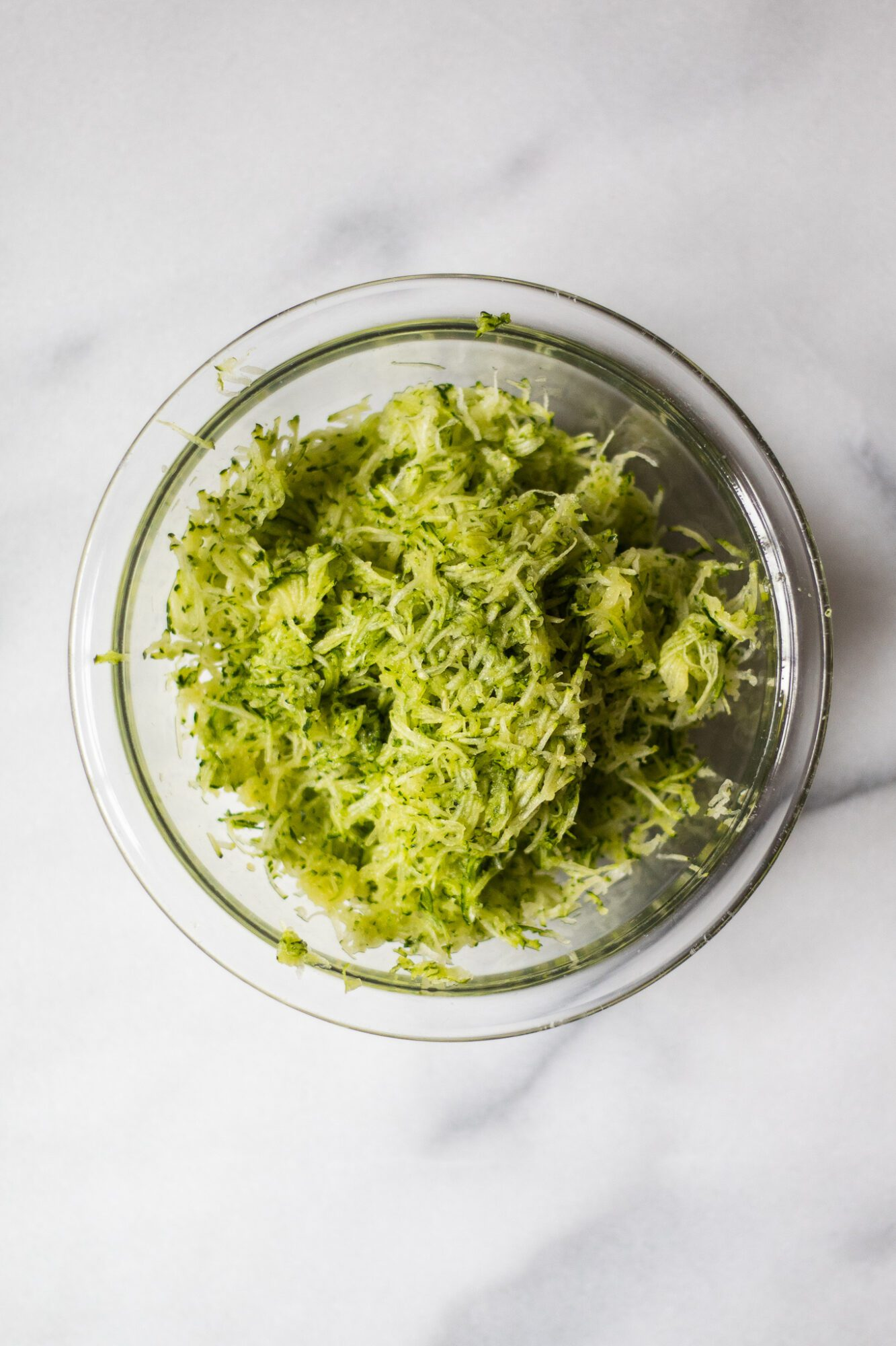 shredded zucchini in bowl
