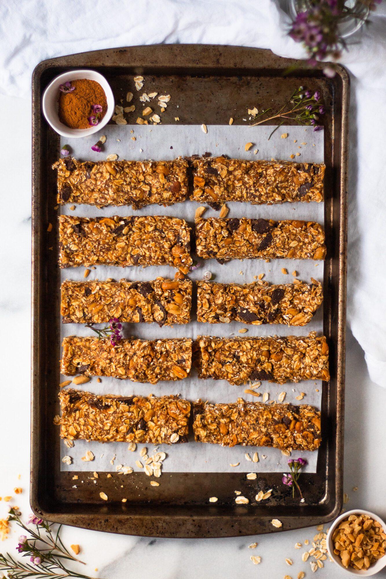 granola bars neatly arranged on baking sheet