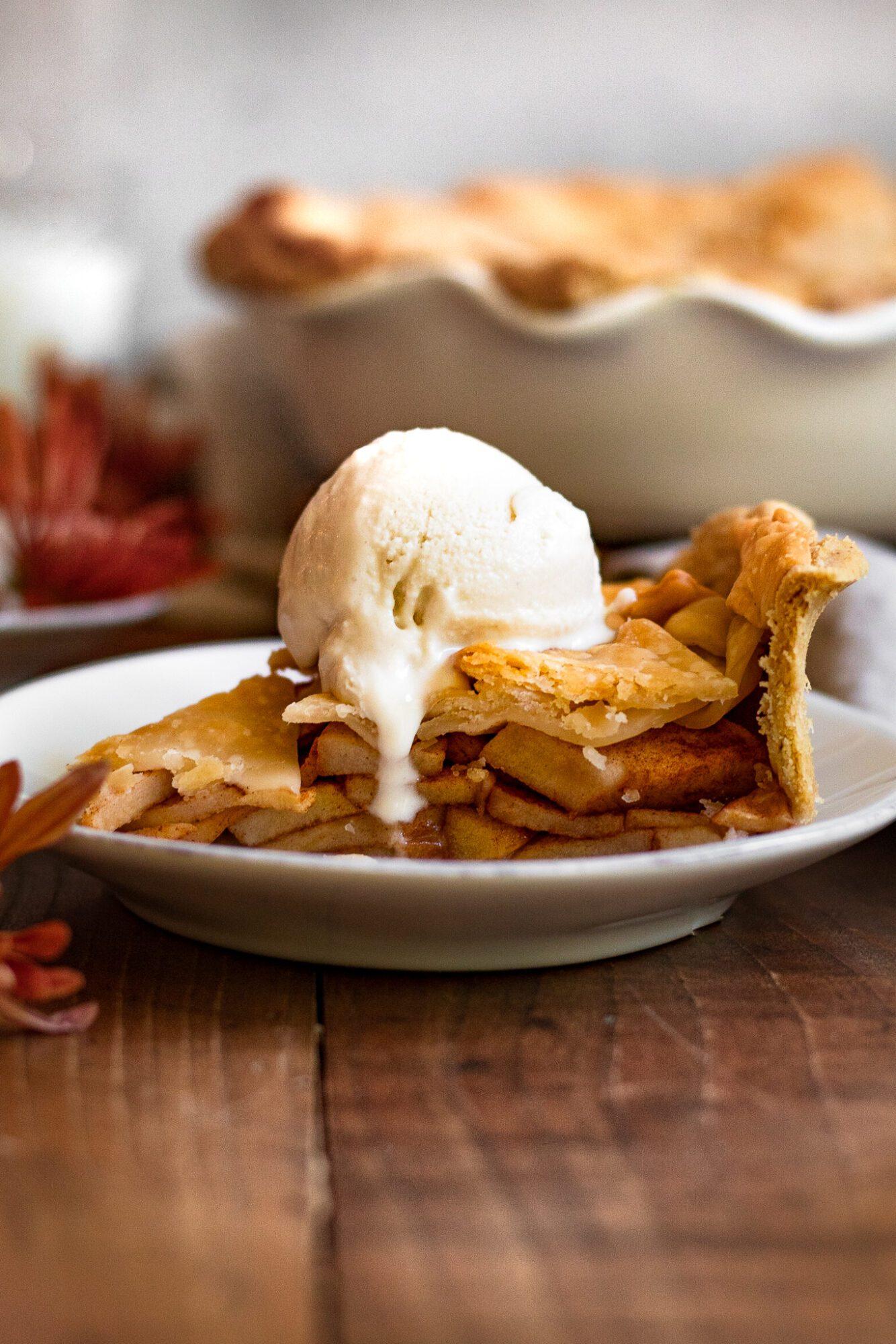 slice of apple pie with scoop of ice cream