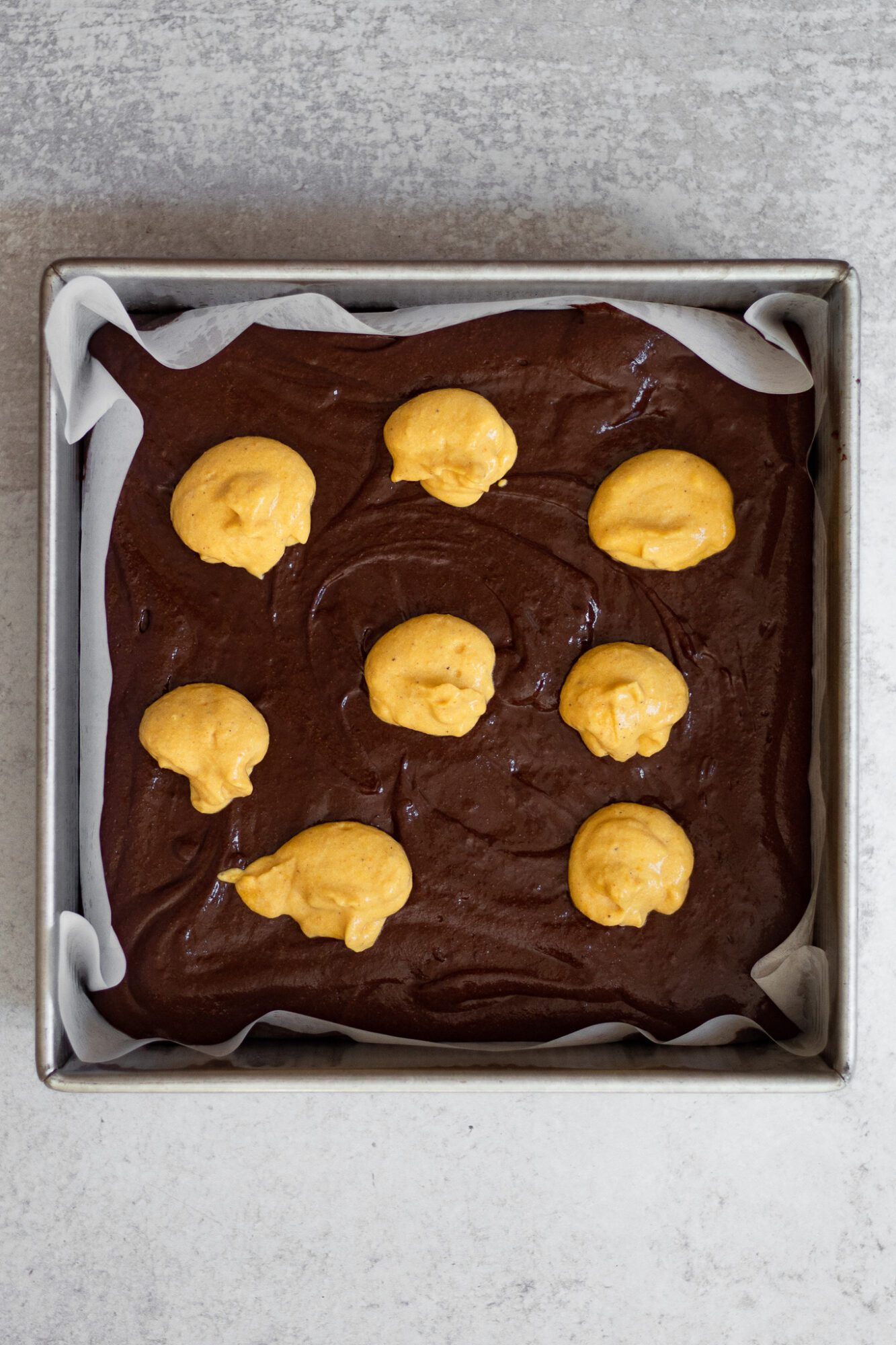 paleo brownie batter with dollops of pumpkin