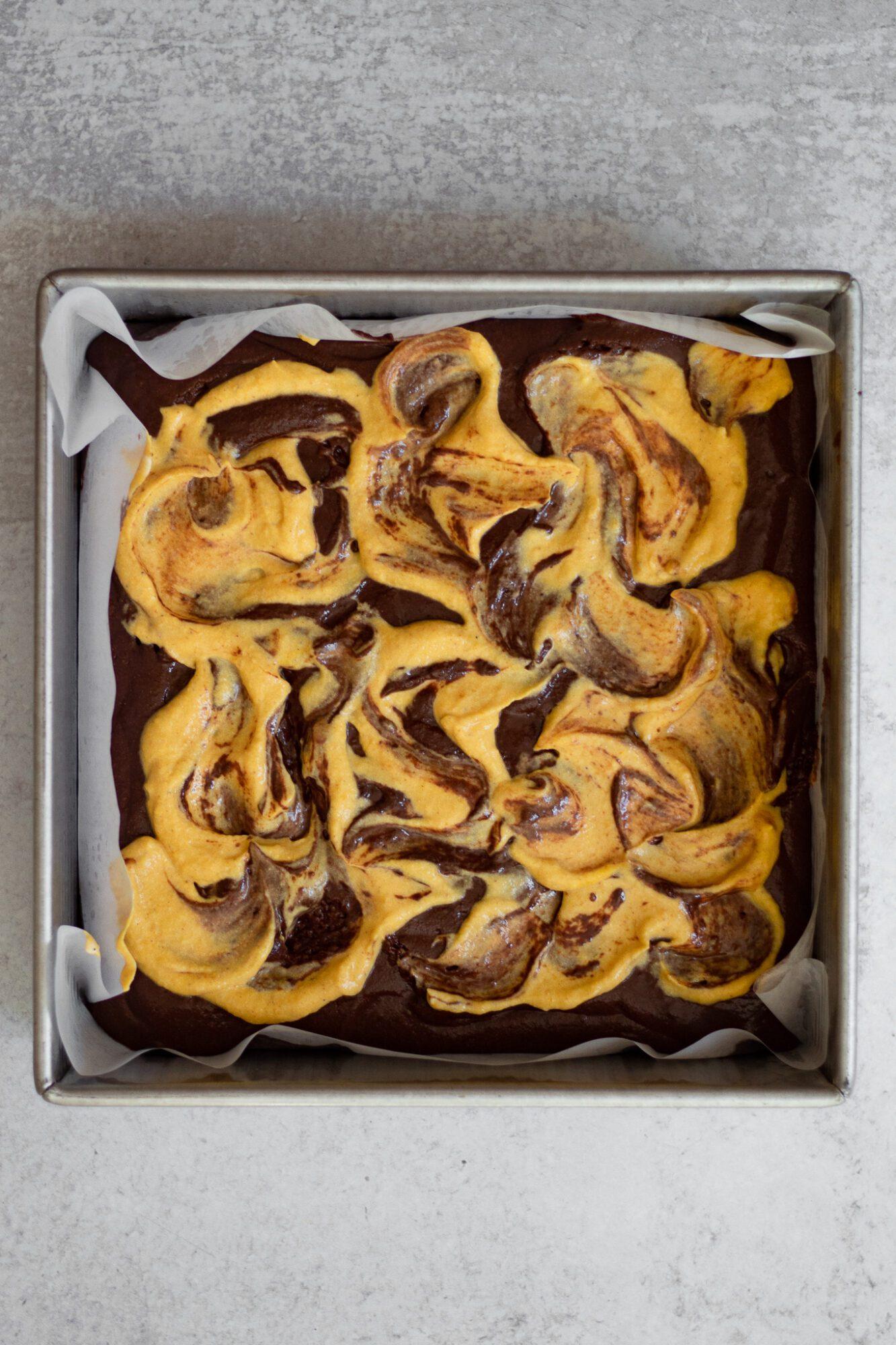 paleo brownie batter swirled with pumpkin cheesecake