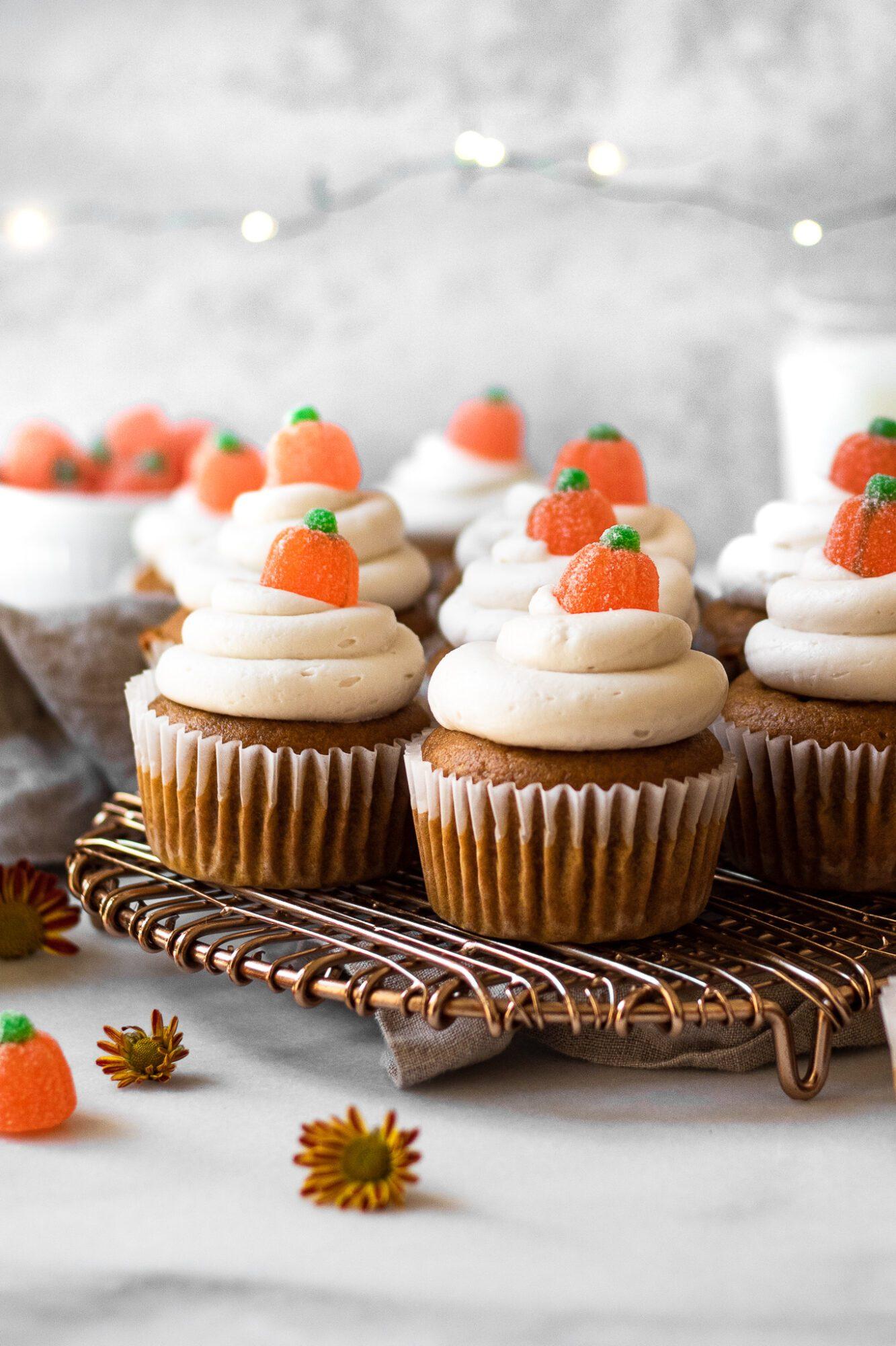 pumpkin cupcakes on cooling rack