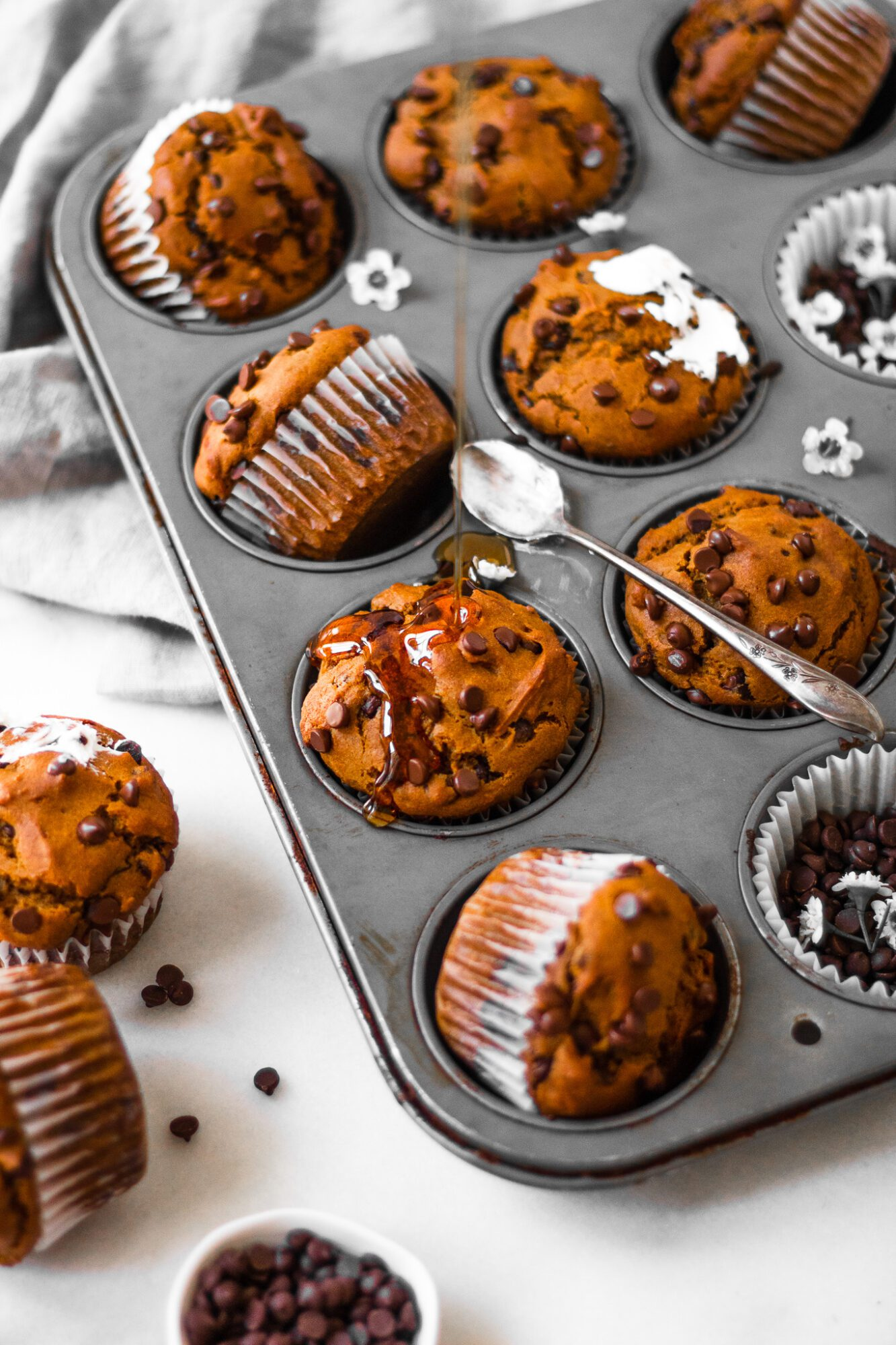maple syrup drizzled onto vegan pumpkin muffins