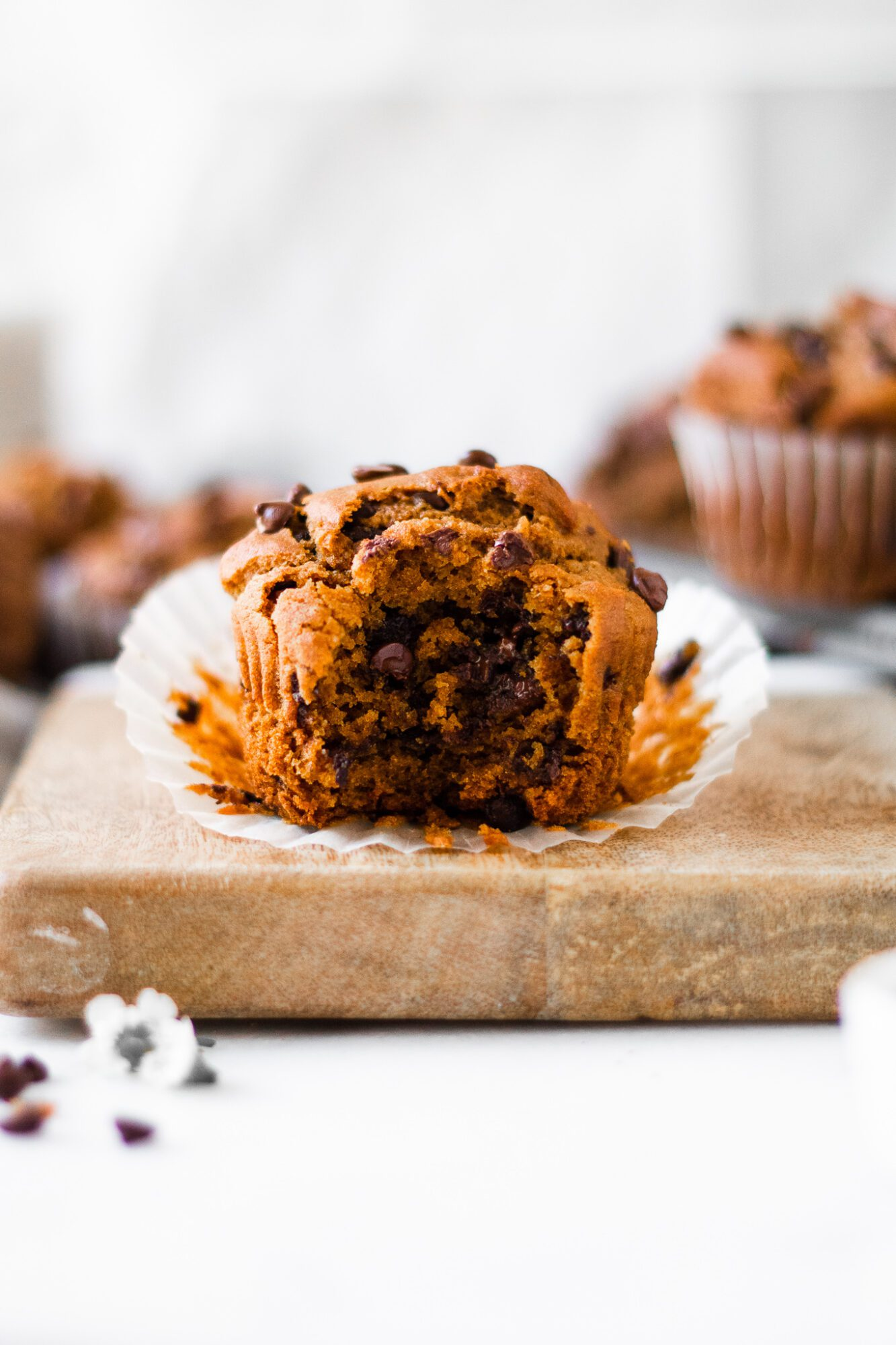 gluten free pumpkin muffin with bite out of it