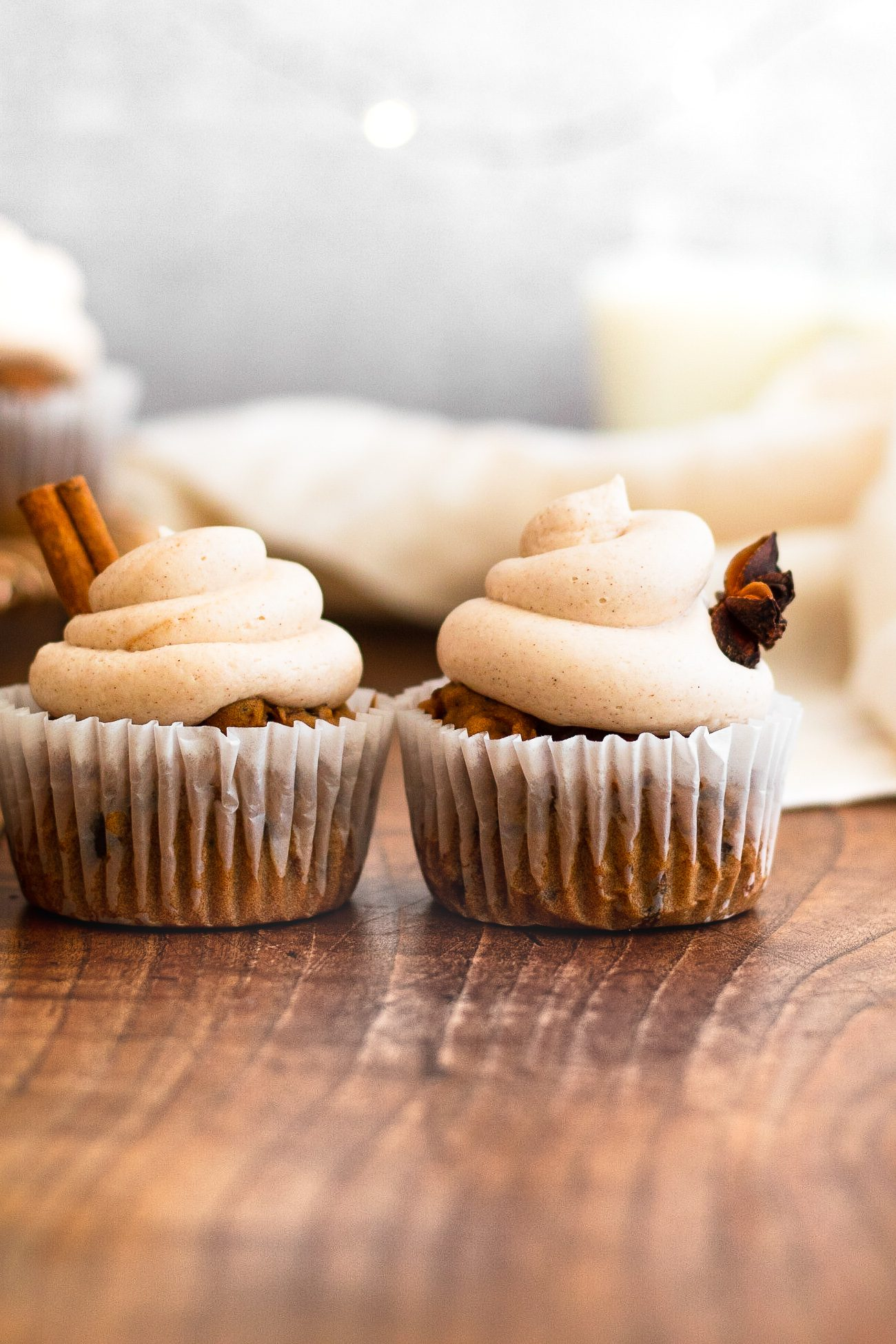 cinnamon cupcakes on wooden board