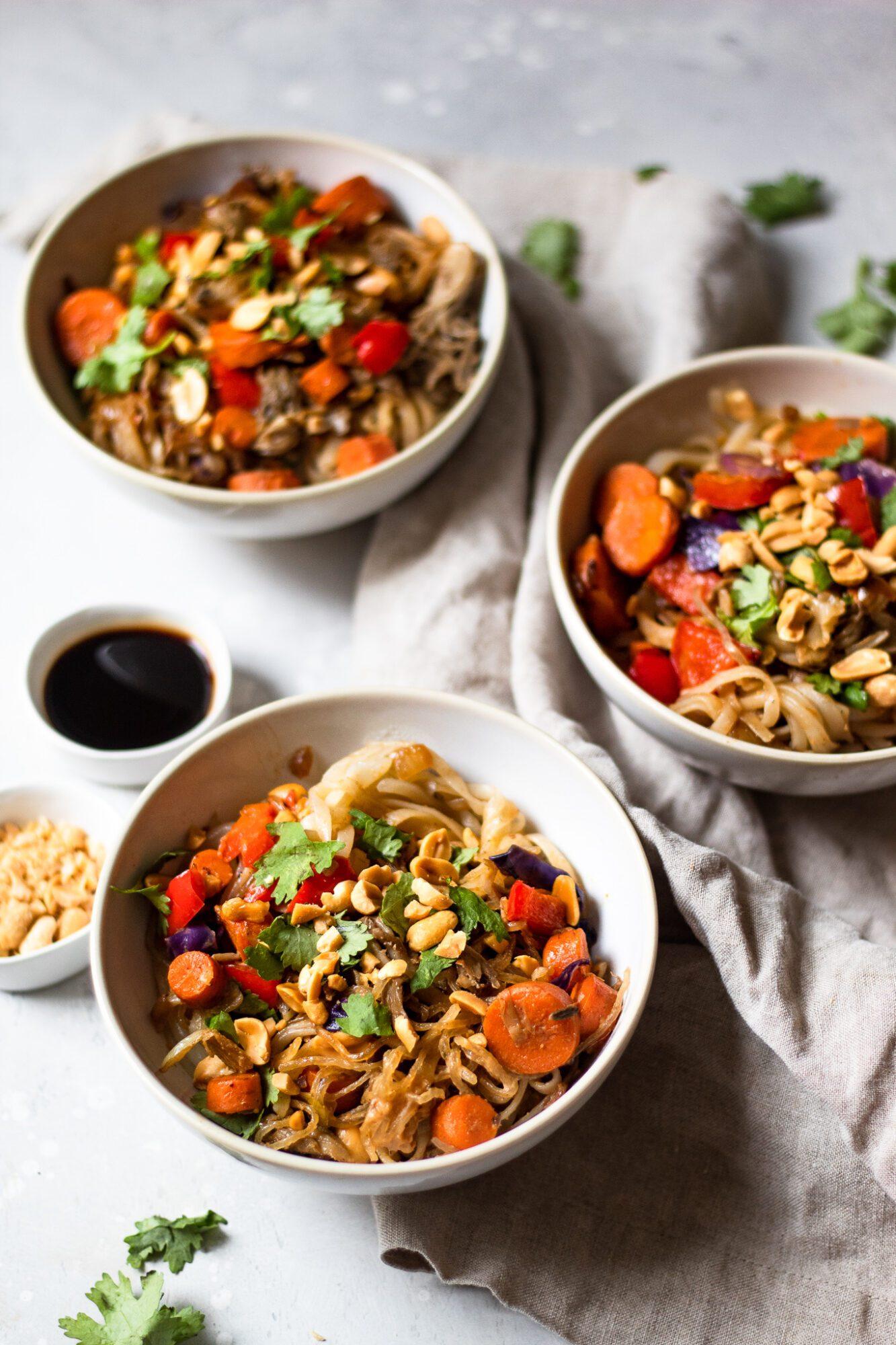 three bowls of pad thai