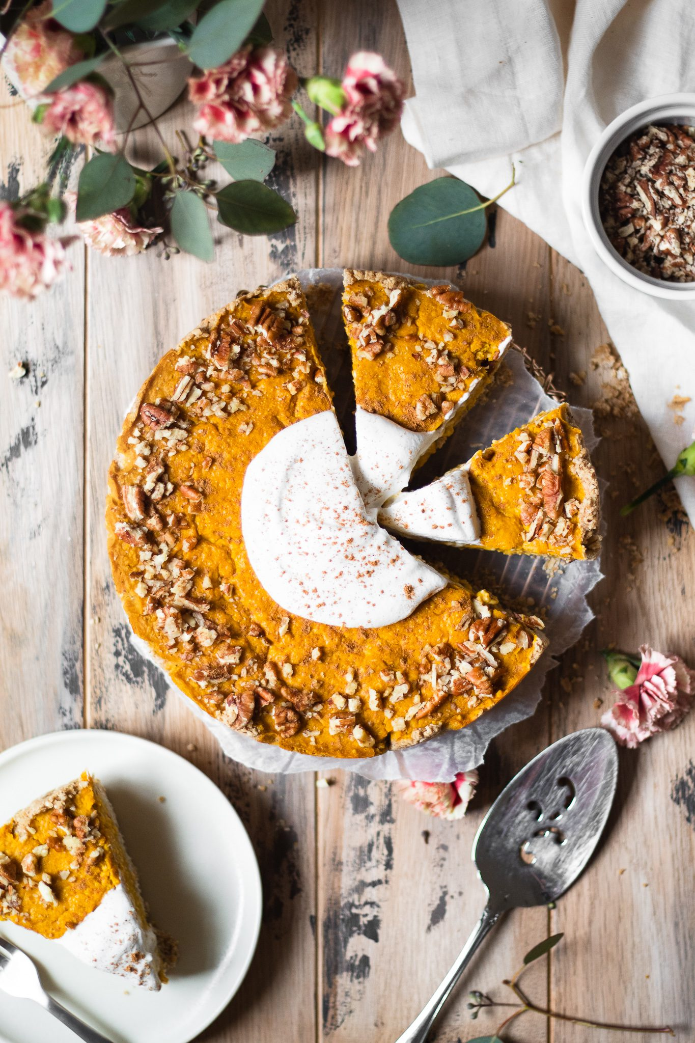 sliced vegan pumpkin cheesecake