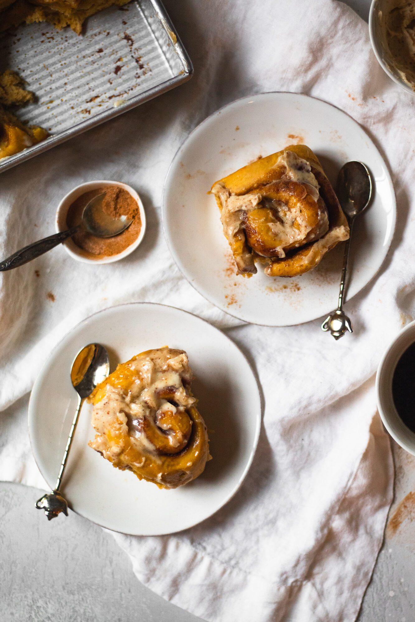 pumpkin cinnamon rolls on plates