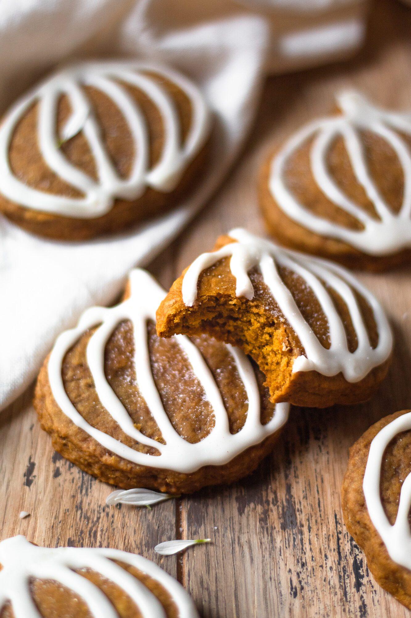 pumpkin sugar cookie with bite taken from it