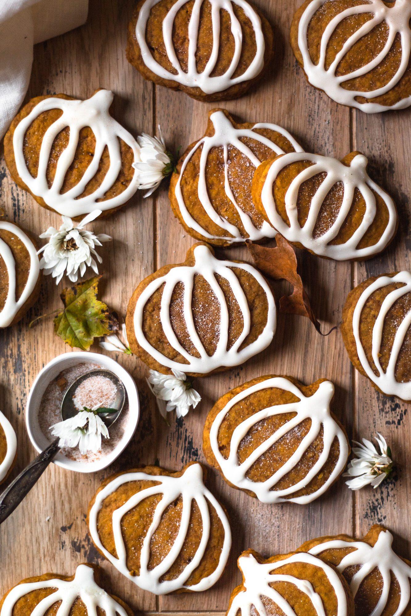 pumpkin sugar cookies on wood board