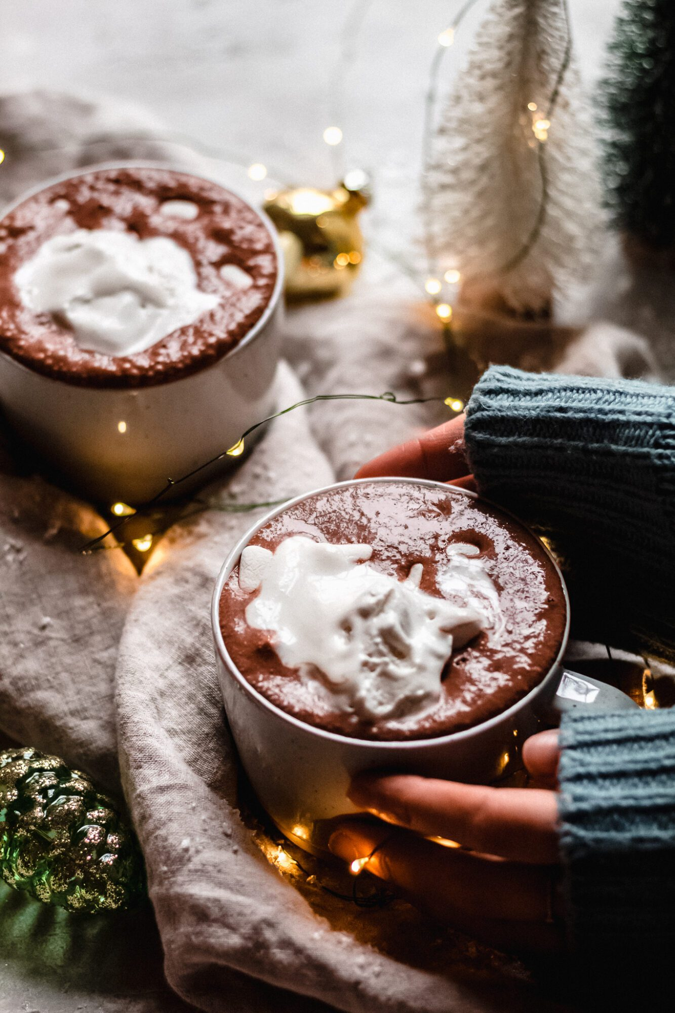 hands holding healthy hot chocolate in mug