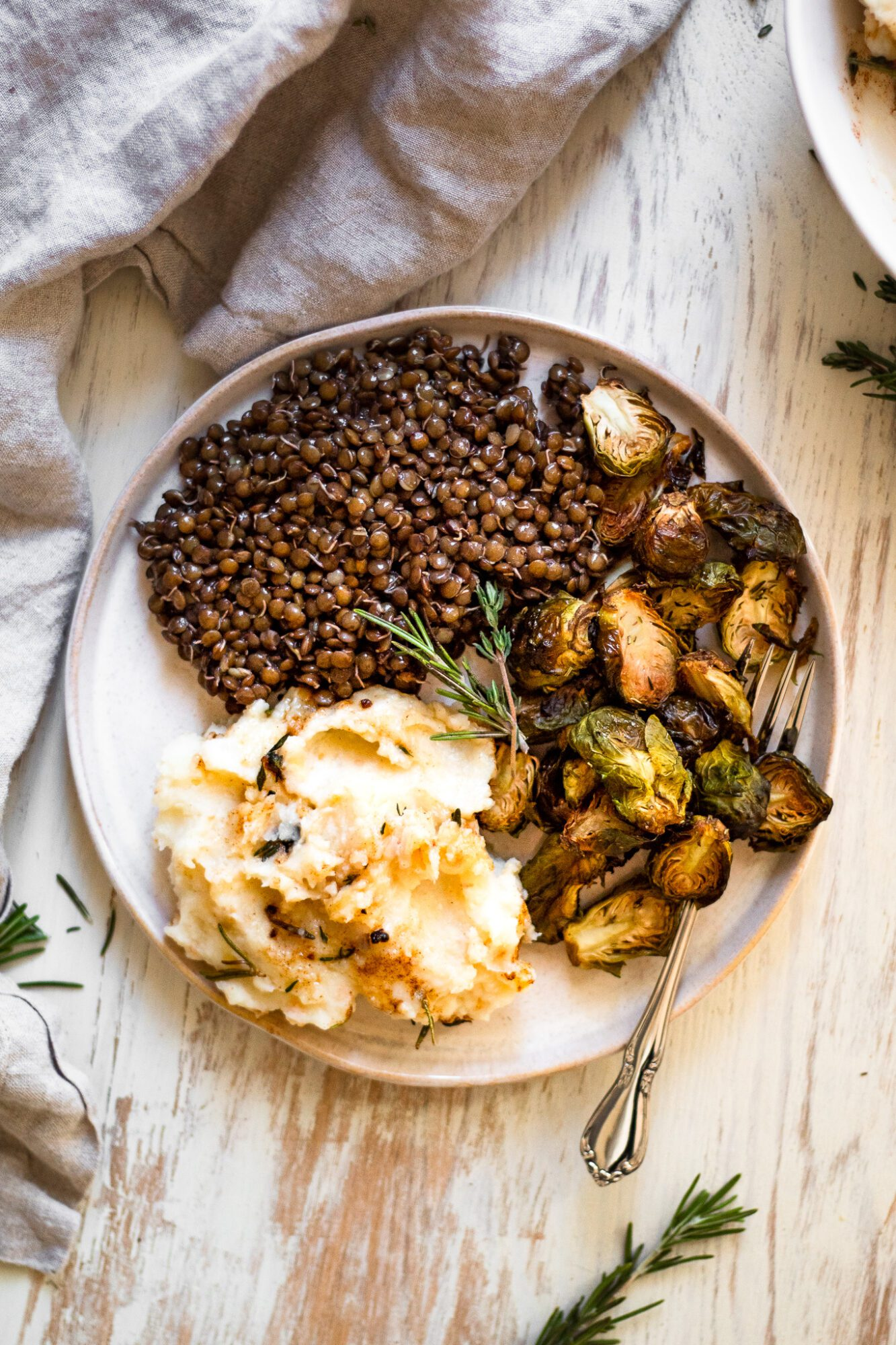 plated mashed potatoes, lentils ,and brussels sprouts