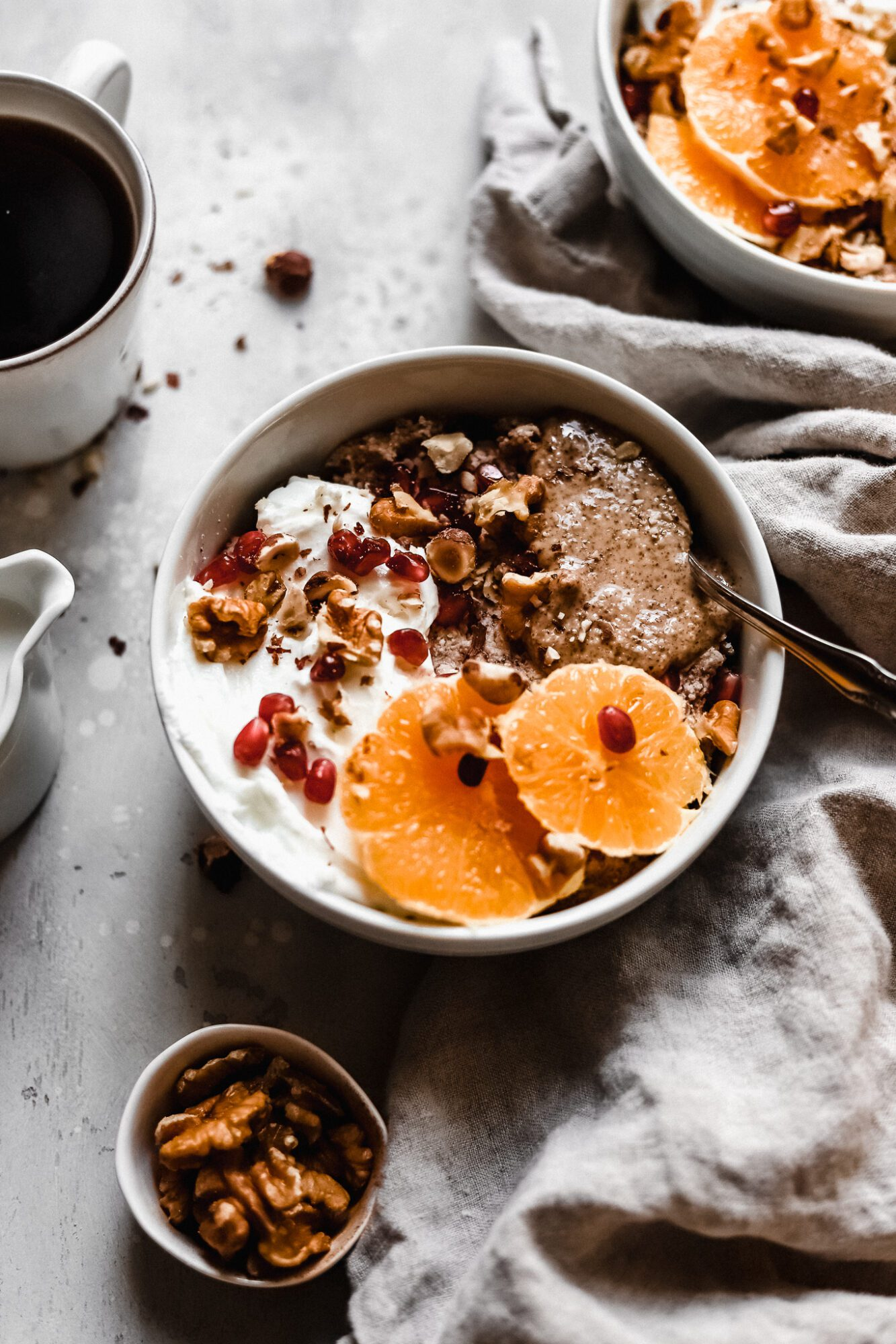 vegan Whole30 breakfast bowl with orange slices and walnuts