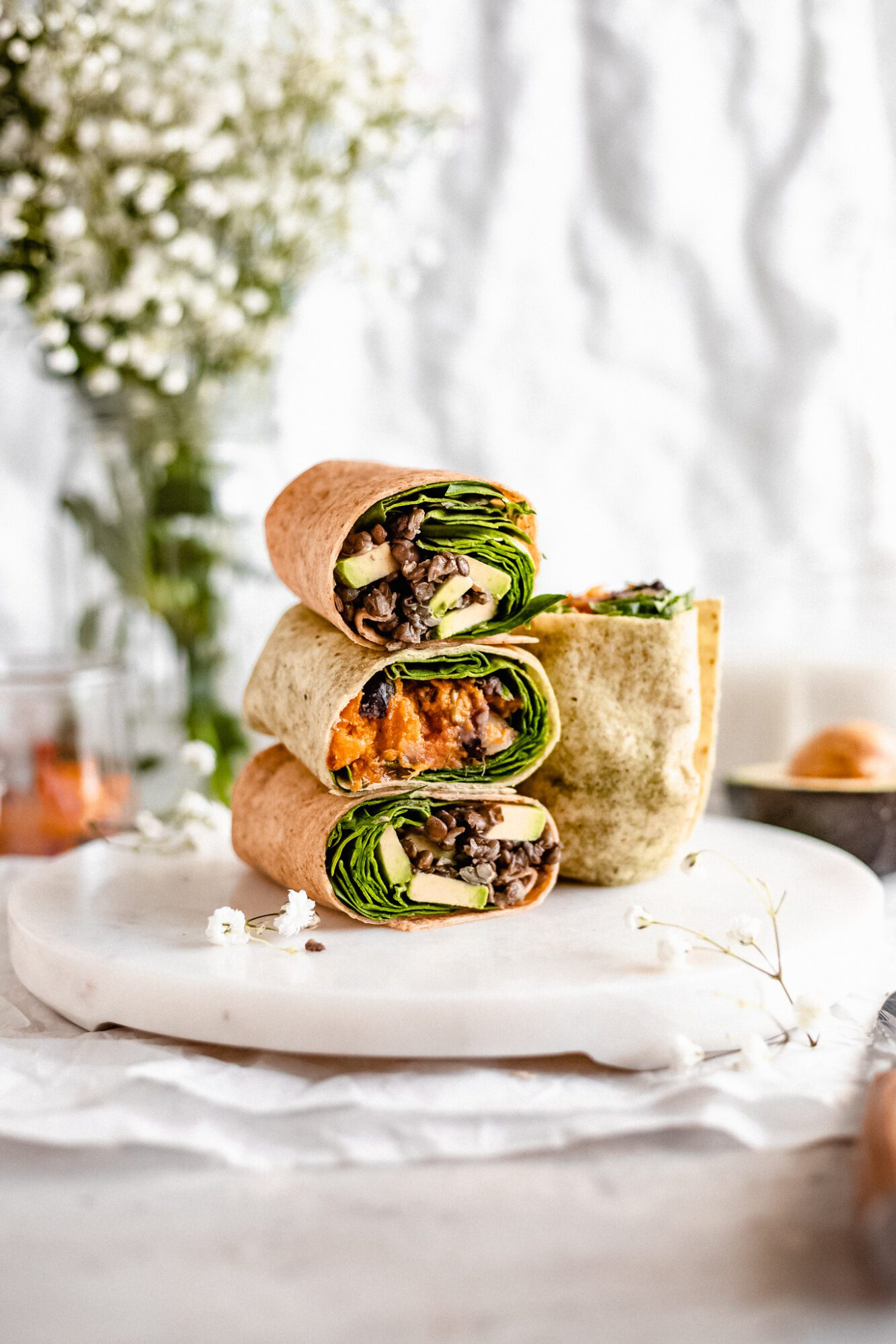 stacked veggie protein vegan breakfast burritos