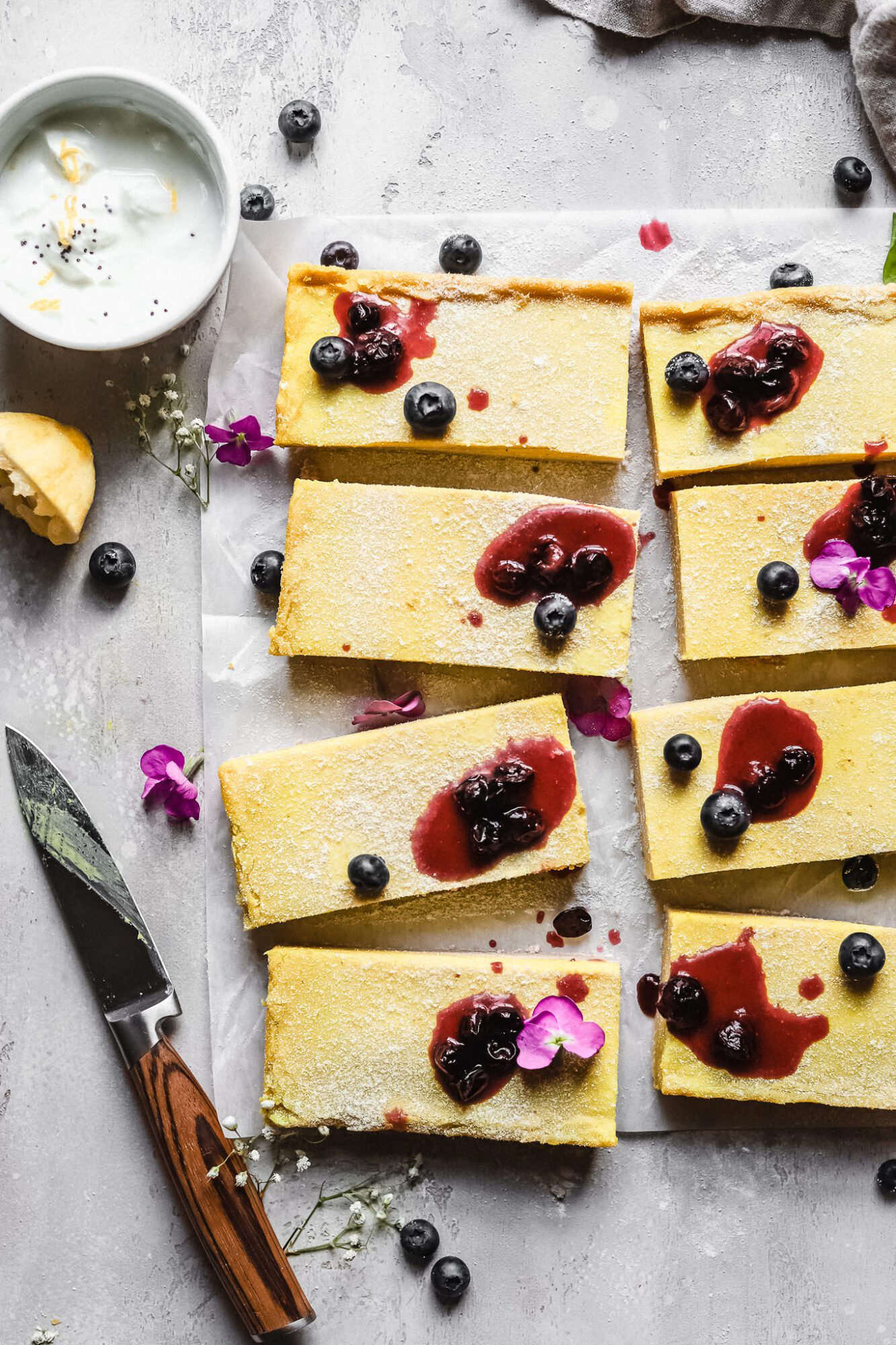 close up of lemon bars with blueberry jam