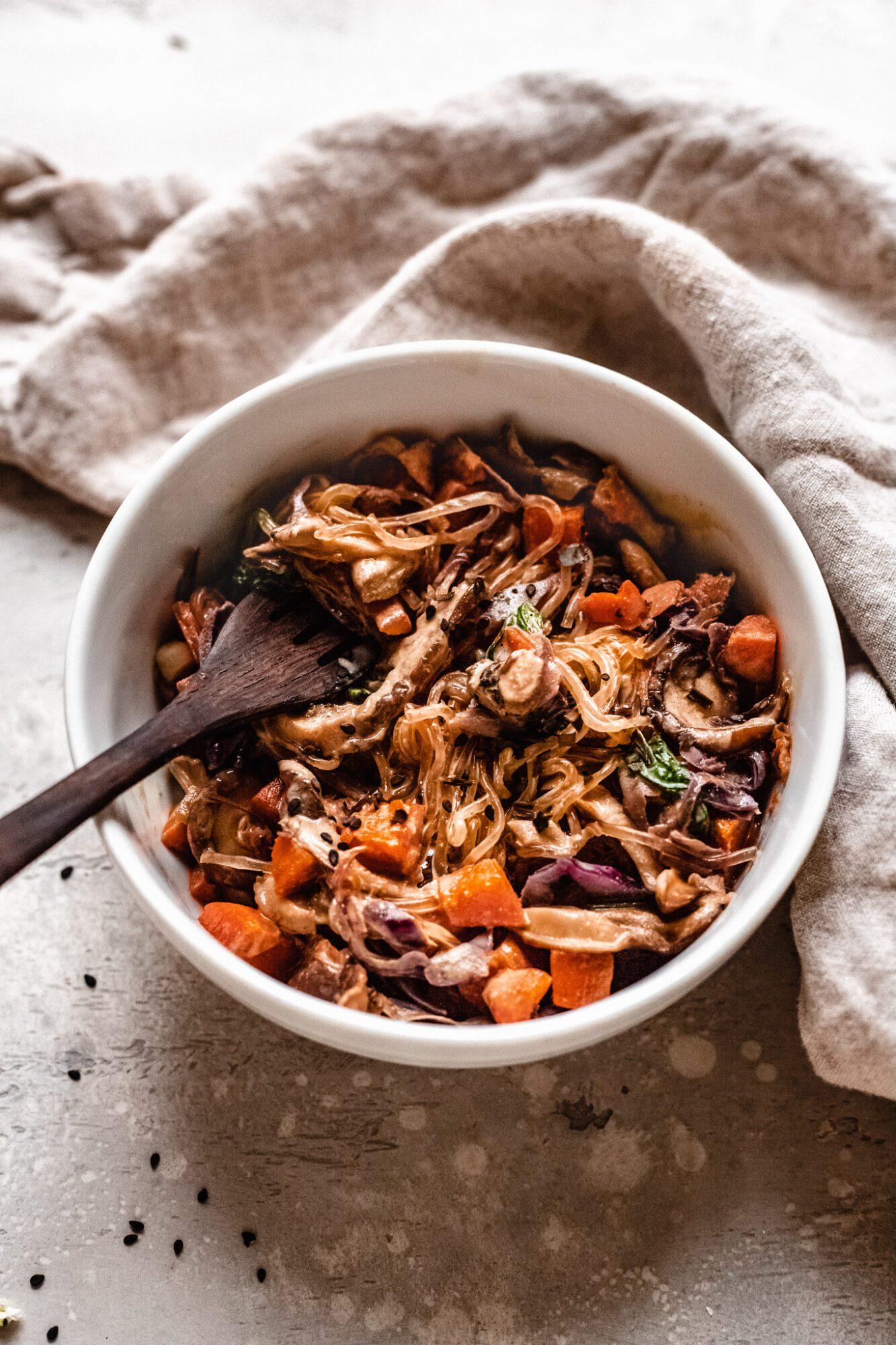 easy paleo vegan lo mein in a white bowl