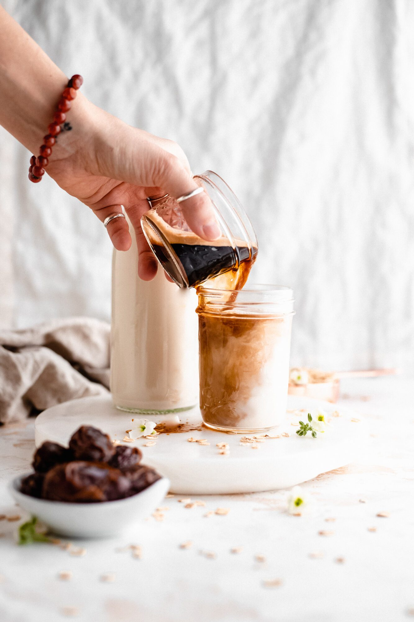 hand pouring espresso shot