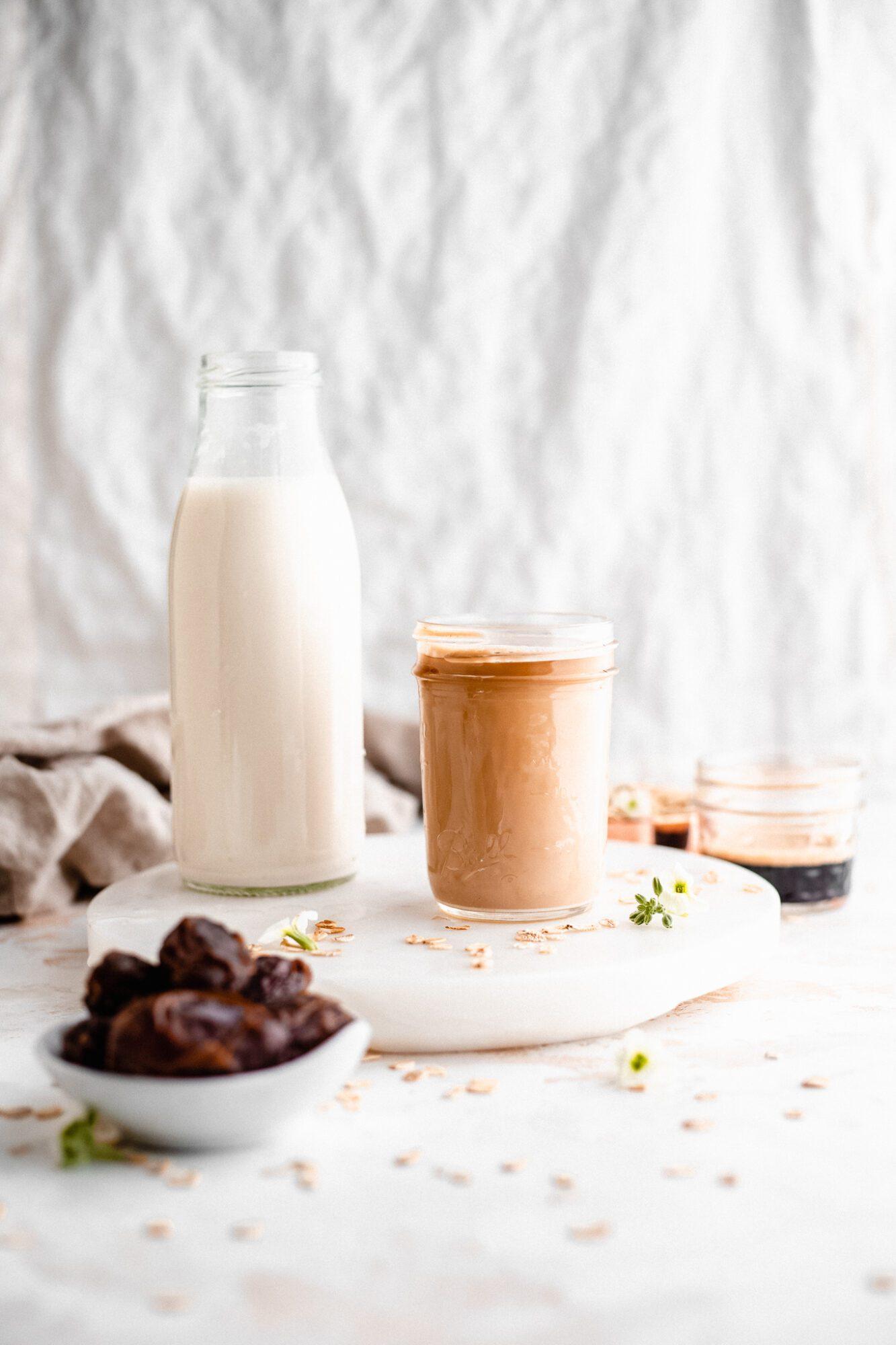 glass of oat milk with espresso
