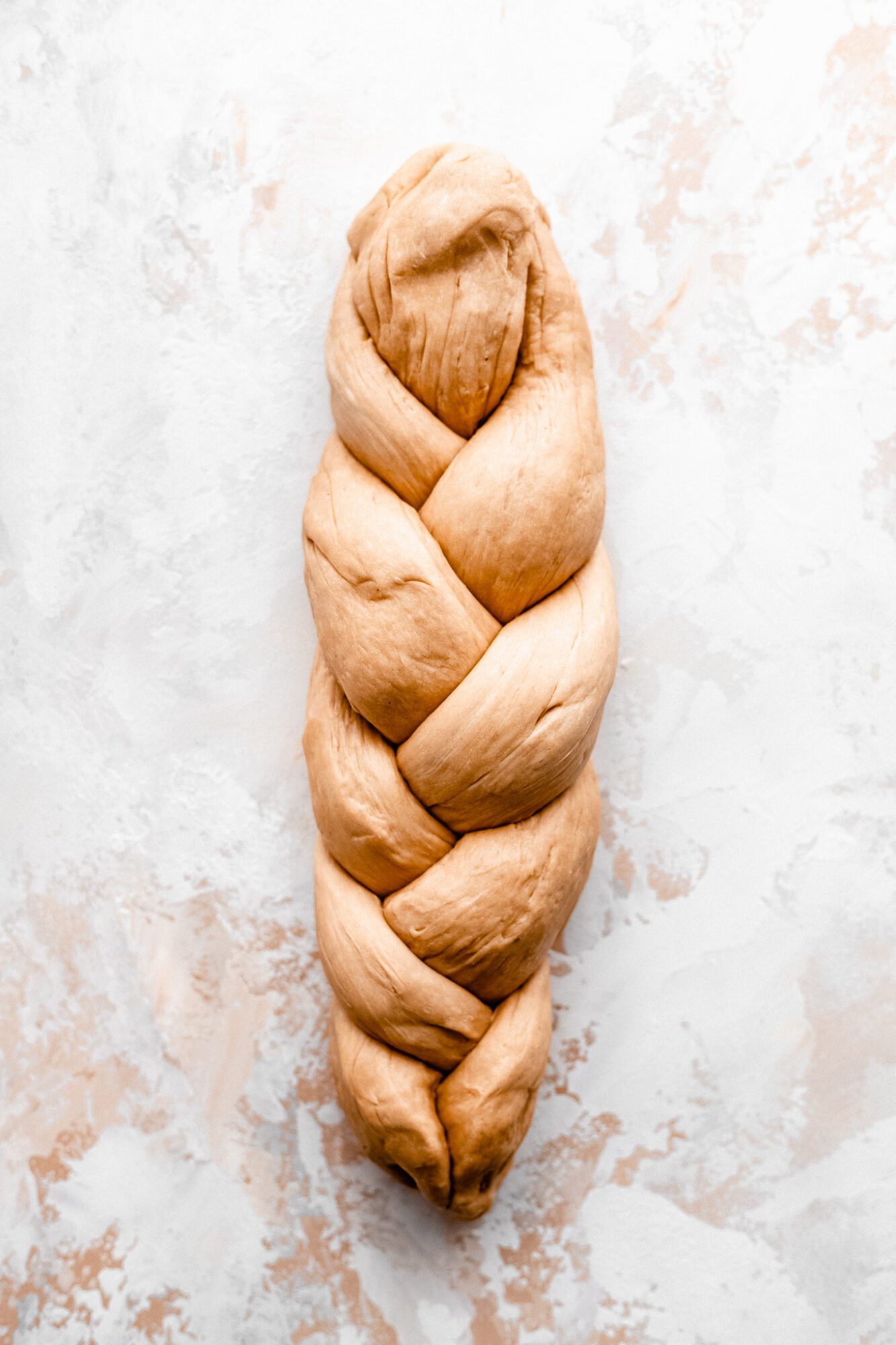 challah dough braided before it bakes