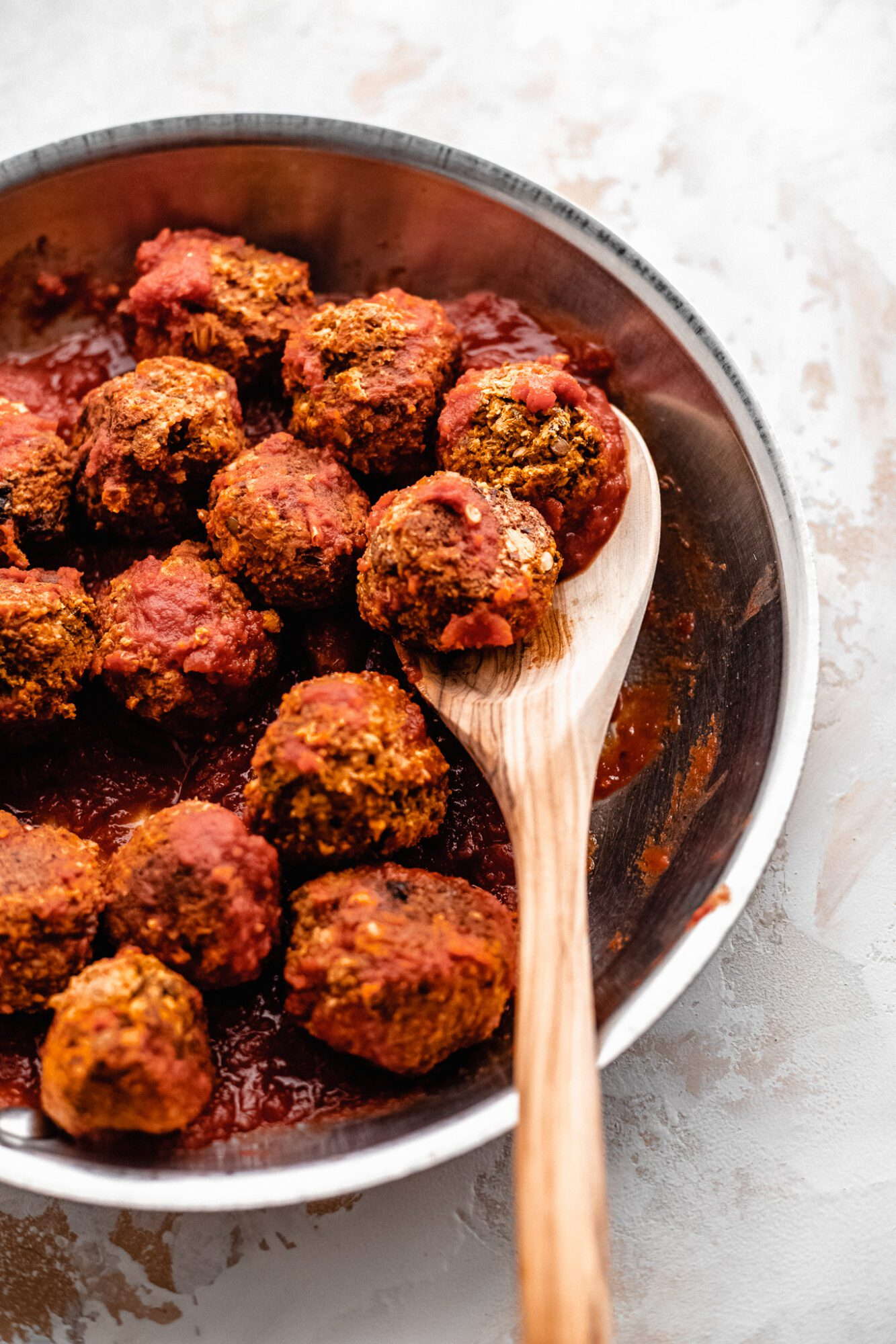 sauce pan with gluten free vegan meatballs