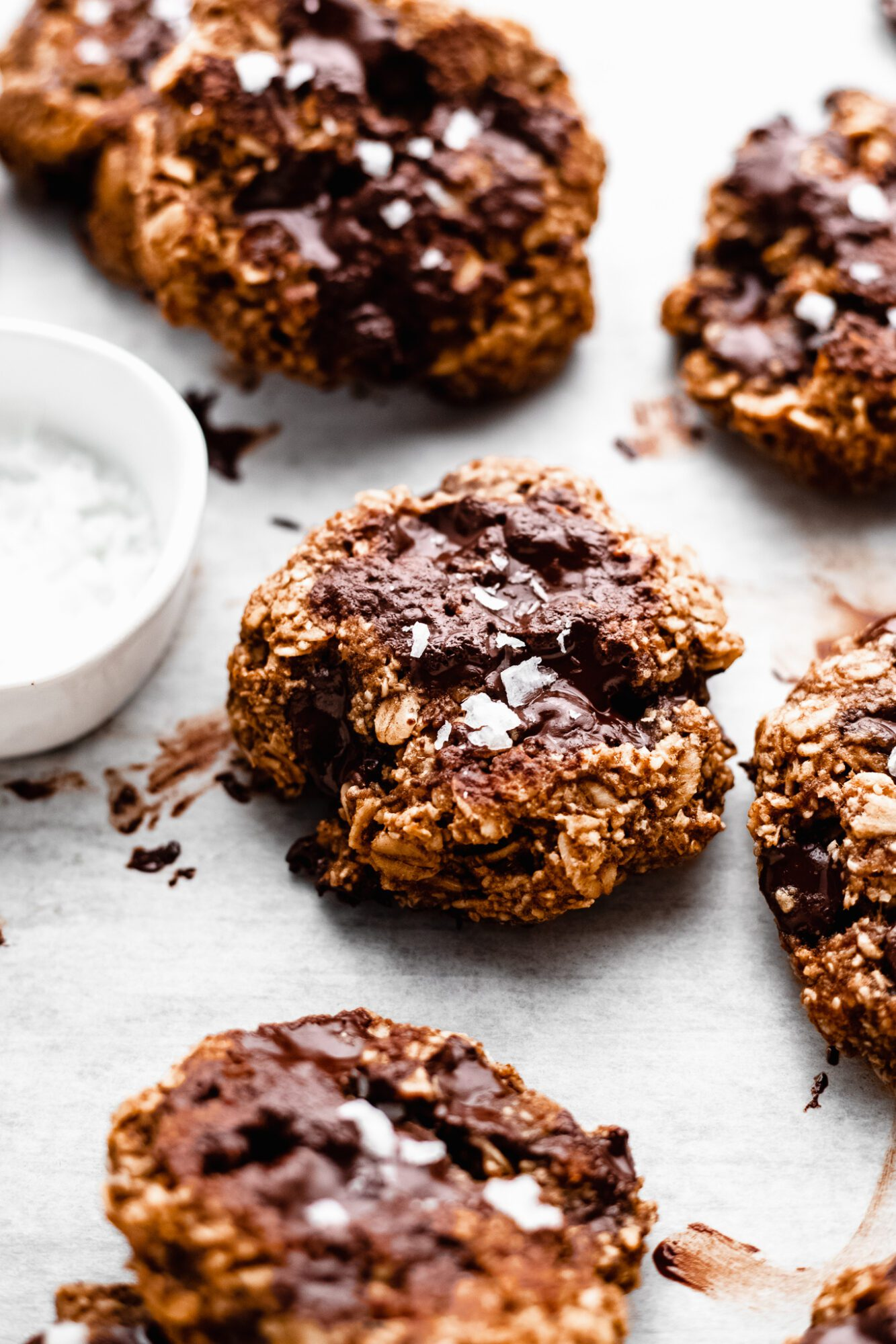 gluten free oatmeal chocolate chip cookies on parchment paper