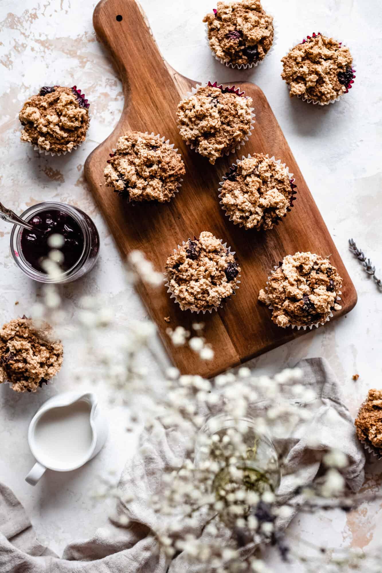 wooden board with gluten free vegan blueberry muffins
